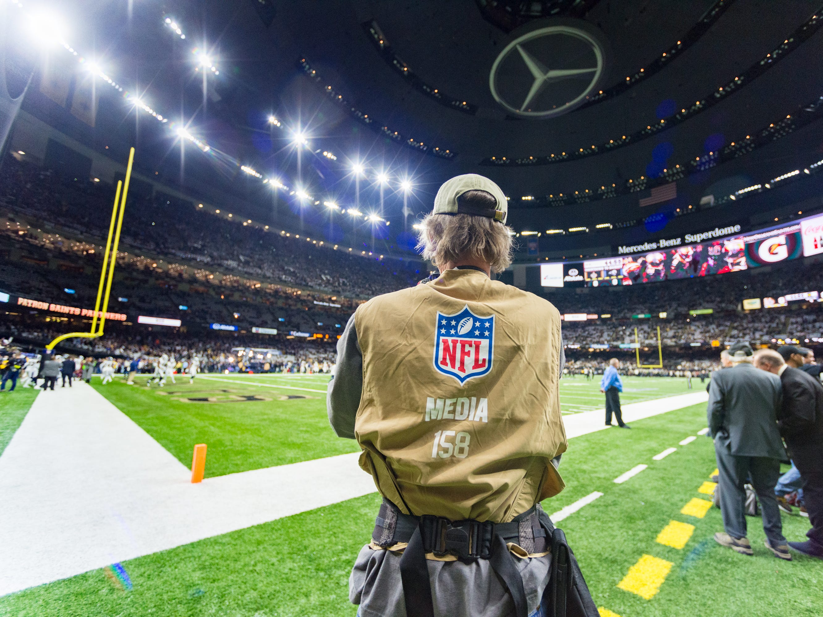 Photojournalist Mark Wallheiser on the sidelines during the NFC Championship playoff football game between the New Orleans Saints and the Los Angeles Rams at the Mercedes-Benz Superdome in New Orleans. Sunday, Jan. 20, 2019.
