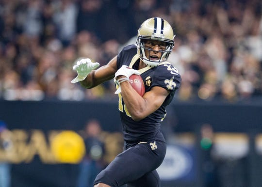 Michael Thomas runs the ball during the NFC Championship playoff football game between the New Orleans Saints and the Los Angeles Rams at the Mercedes-Benz Superdome in New Orleans. Sunday, Jan. 20, 2019.