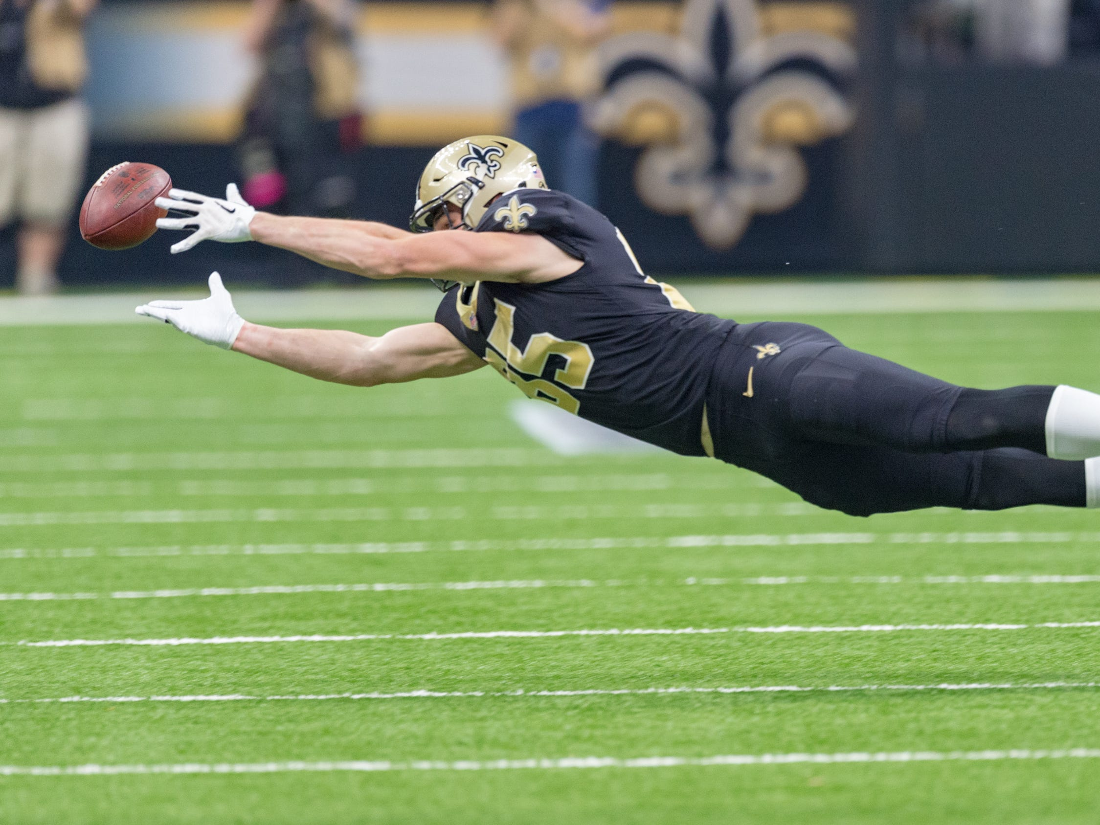 Saints tight end Dan Arnold dives for a ball during the NFC Championship playoff football game between the New Orleans Saints and the Los Angeles Rams at the Mercedes-Benz Superdome in New Orleans. Sunday, Jan. 20, 2019.