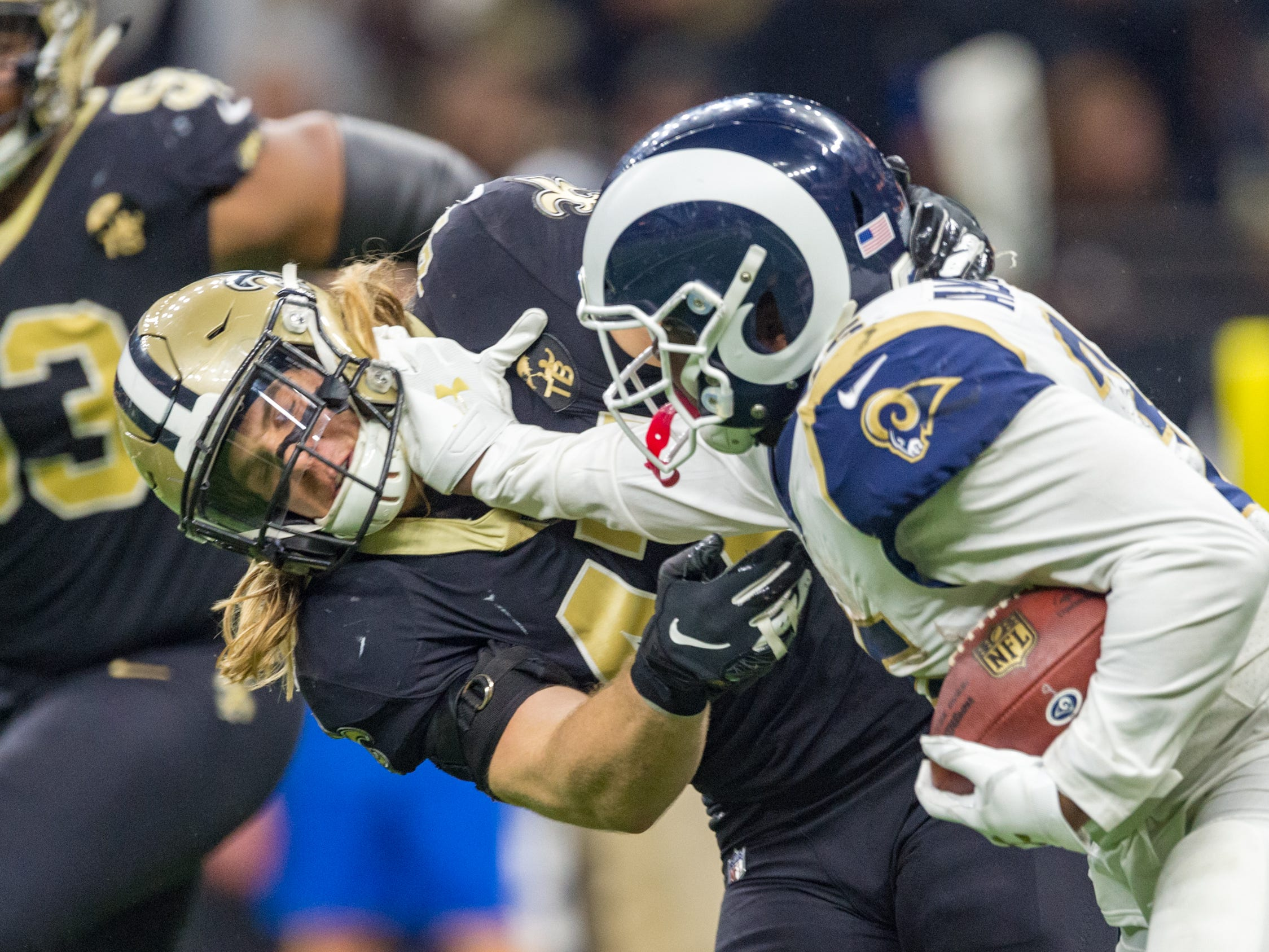 Rams runningback CJ Anderson stiff arms Saints linebacker Alex Anzalone during the NFC Championship playoff football game between the New Orleans Saints and the Los Angeles Rams at the Mercedes-Benz Superdome in New Orleans. Sunday, Jan. 20, 2019.