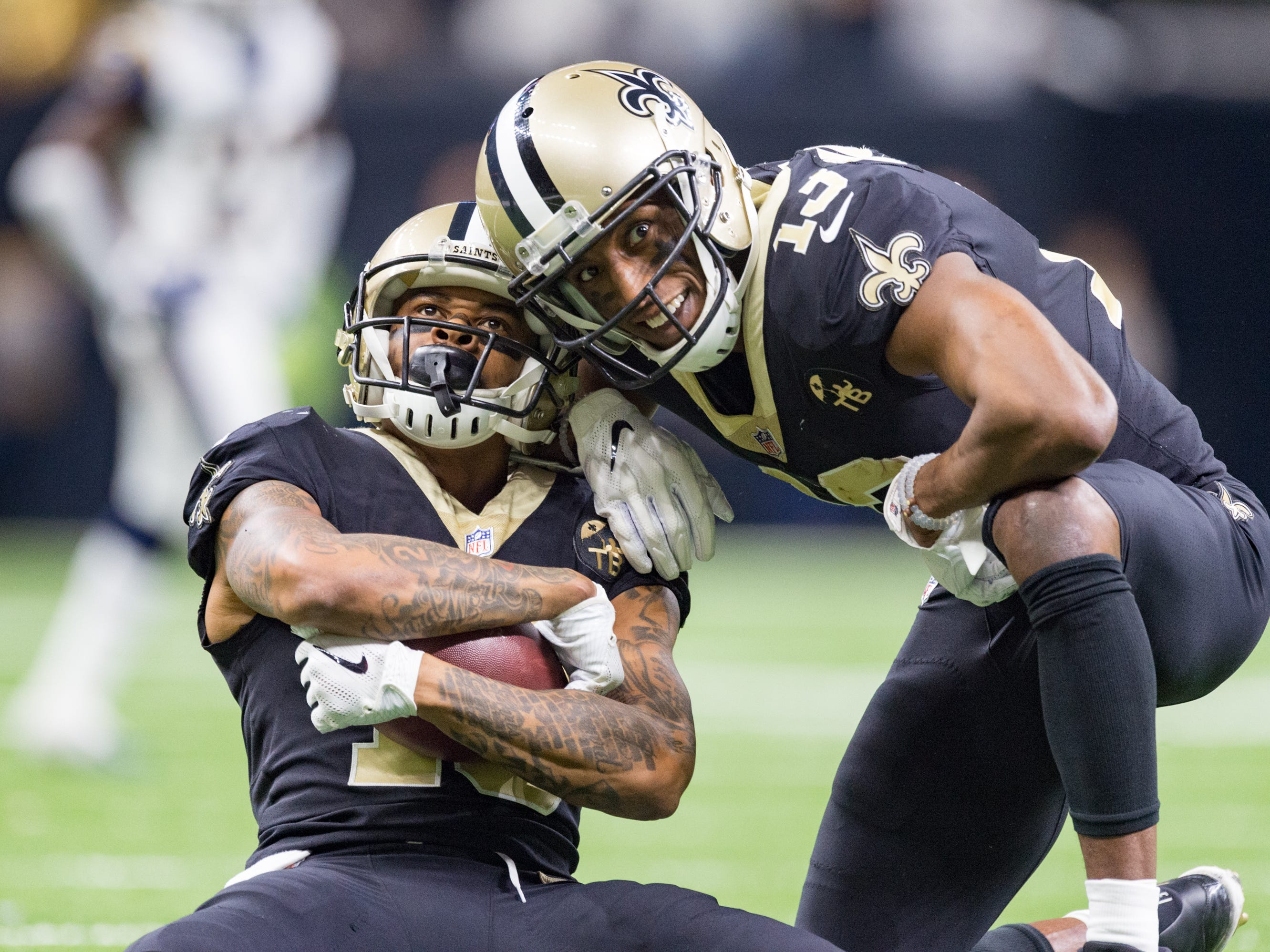 Saints receiver Ted Ginn Jr. makes a catch for a first down and poses for a photo with Michael Thomas during the NFC Championship playoff football game between the New Orleans Saints and the Los Angeles Rams at the Mercedes-Benz Superdome in New Orleans. Sunday, Jan. 20, 2019.