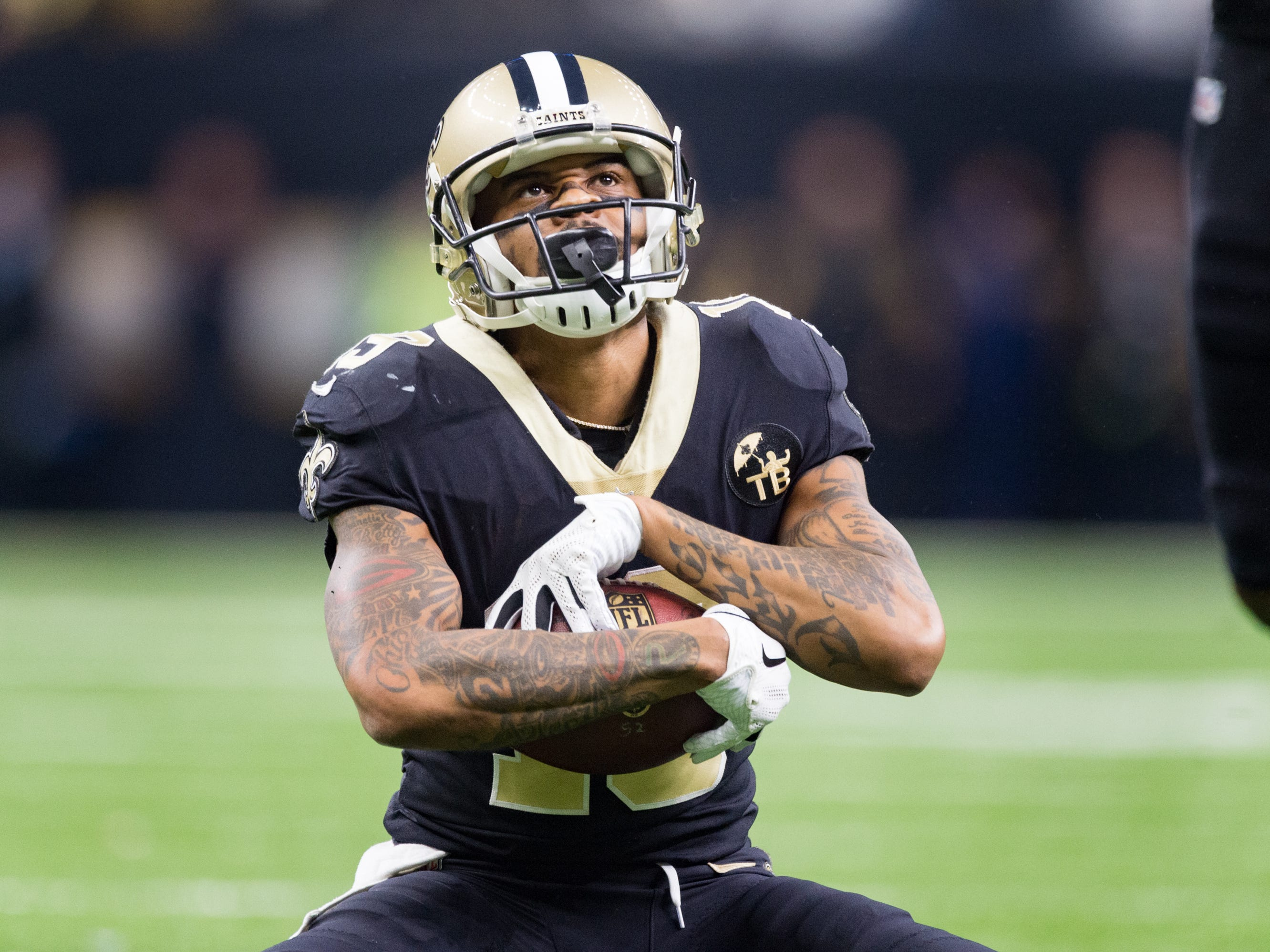 Saints receiver Ted Ginn Jr makes a catch for a first down and poses for a photo with Michael Thomas during the NFC Championship playoff football game between the New Orleans Saints and the Los Angeles Rams at the Mercedes-Benz Superdome in New Orleans. Sunday, Jan. 20, 2019.
