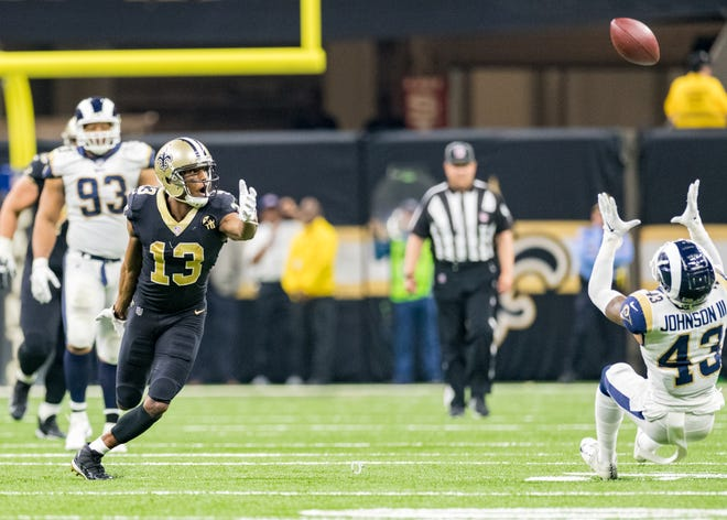 Saints quarterback Drew Brees throws an interception intended for Michael Thomas during Sunday's NFC Championship against the Los Angeles Rams at the Mercedes-Benz Superdome in New Orleans.