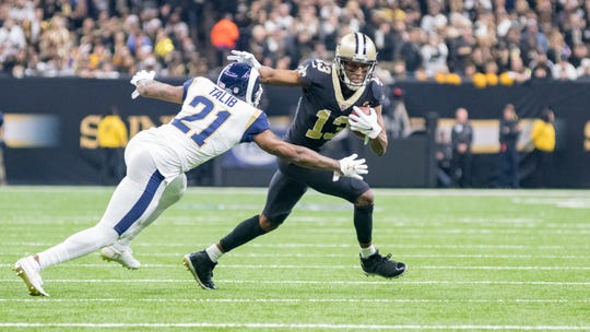 Michael Thomas runs the ball Sunday during the NFC Championship against the Los Angeles Rams in New Orleans.