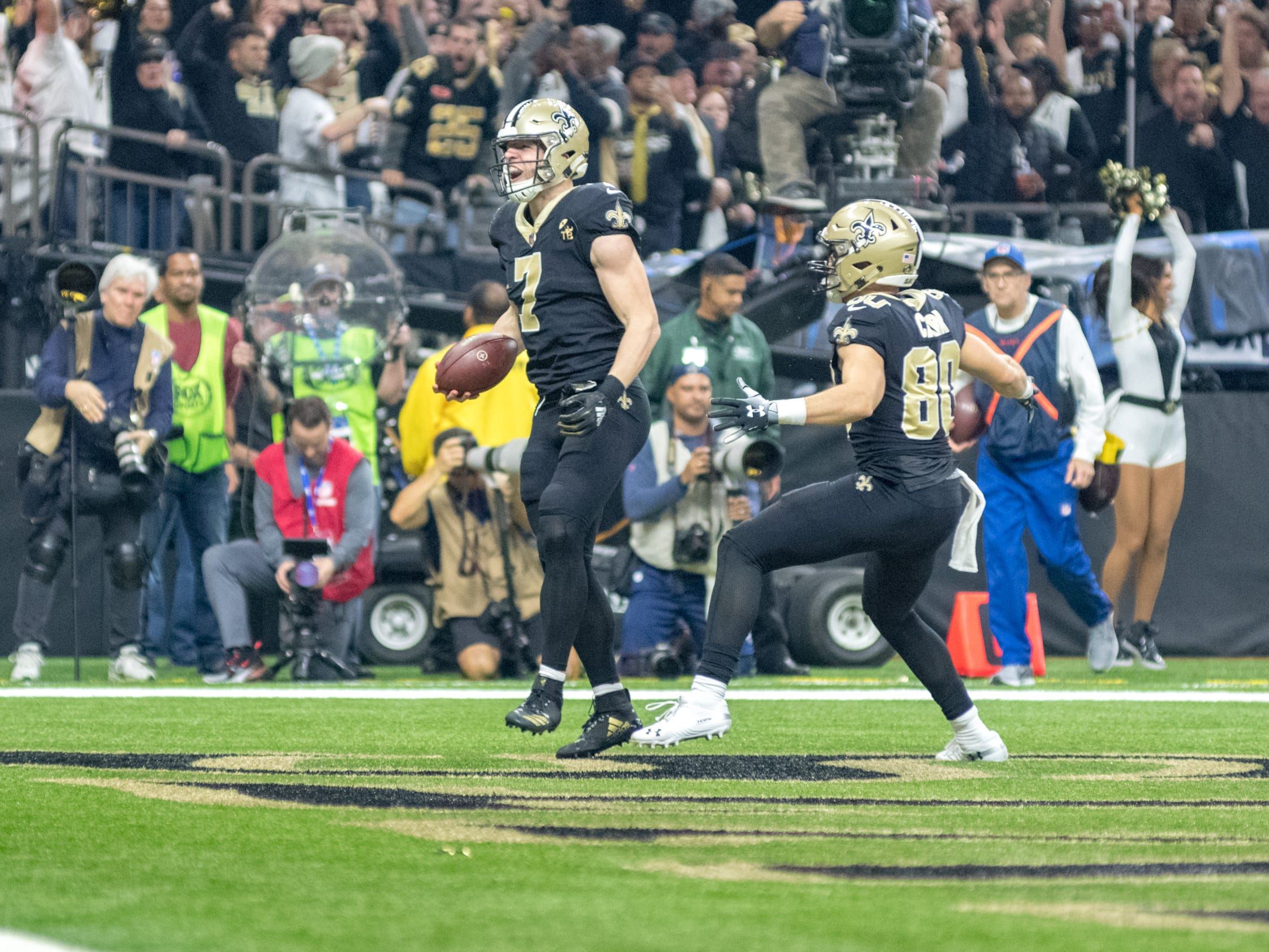 Taysom Hill scores a touchdown during the NFC Championship playoff football game between the New Orleans Saints and the Los Angeles Rams at the Mercedes-Benz Superdome in New Orleans. Sunday, Jan. 20, 2019.