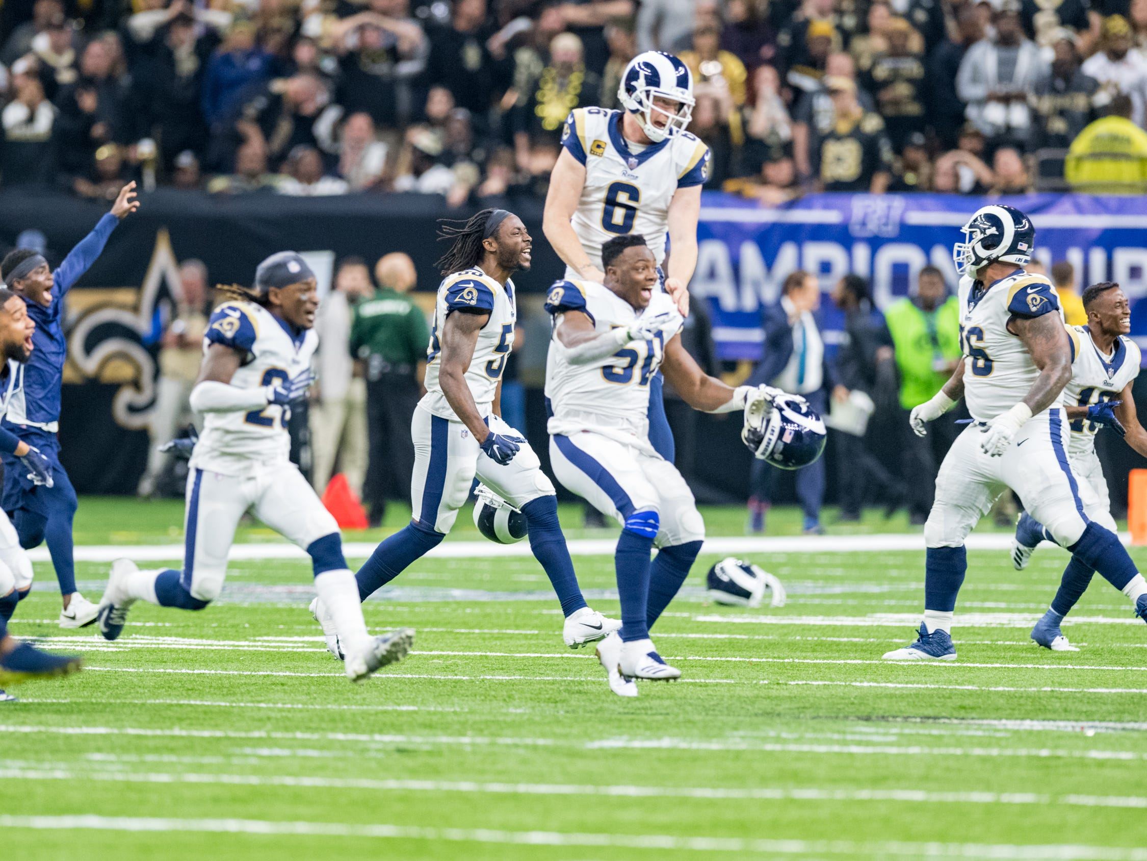 Rams players react after Greg Zuerlein field goal in overtime to win the NFC Championship playoff football game between the New Orleans Saints and the Los Angeles Rams at the Mercedes-Benz Superdome in New Orleans. Sunday, Jan. 20, 2019.