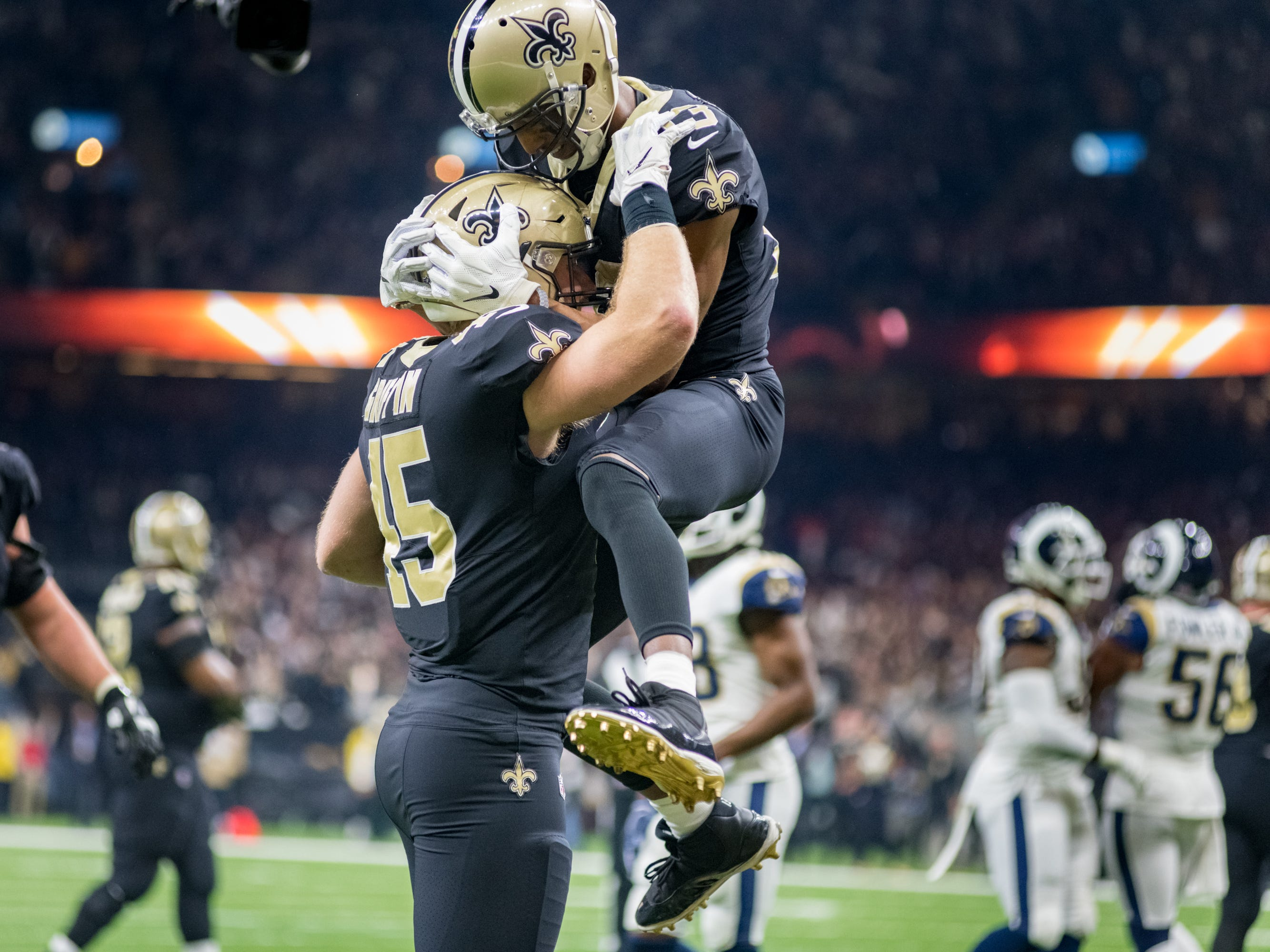 Michael Thomas celebrates a Garrett Griffin touchdown during the NFC Championship playoff football game between the New Orleans Saints and the Los Angeles Rams at the Mercedes-Benz Superdome in New Orleans. Sunday, Jan. 20, 2019.