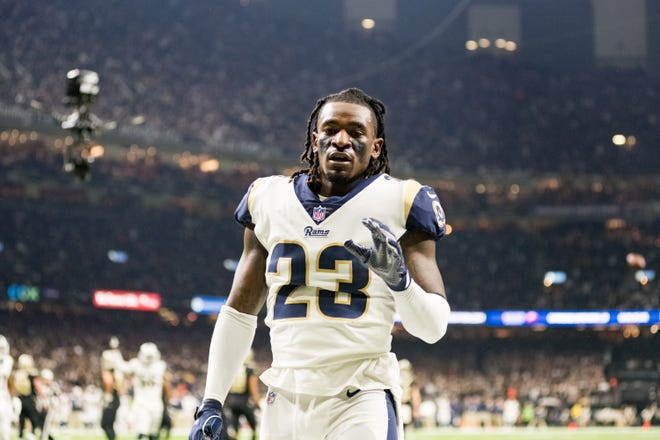 Rams corner back Nickell Robey-Coleman loses helmet breaking up a pass during the NFC Championship playoff football game between the New Orleans Saints and the Los Angeles Rams at the Mercedes-Benz Superdome in New Orleans. Sunday, Jan. 20, 2019.