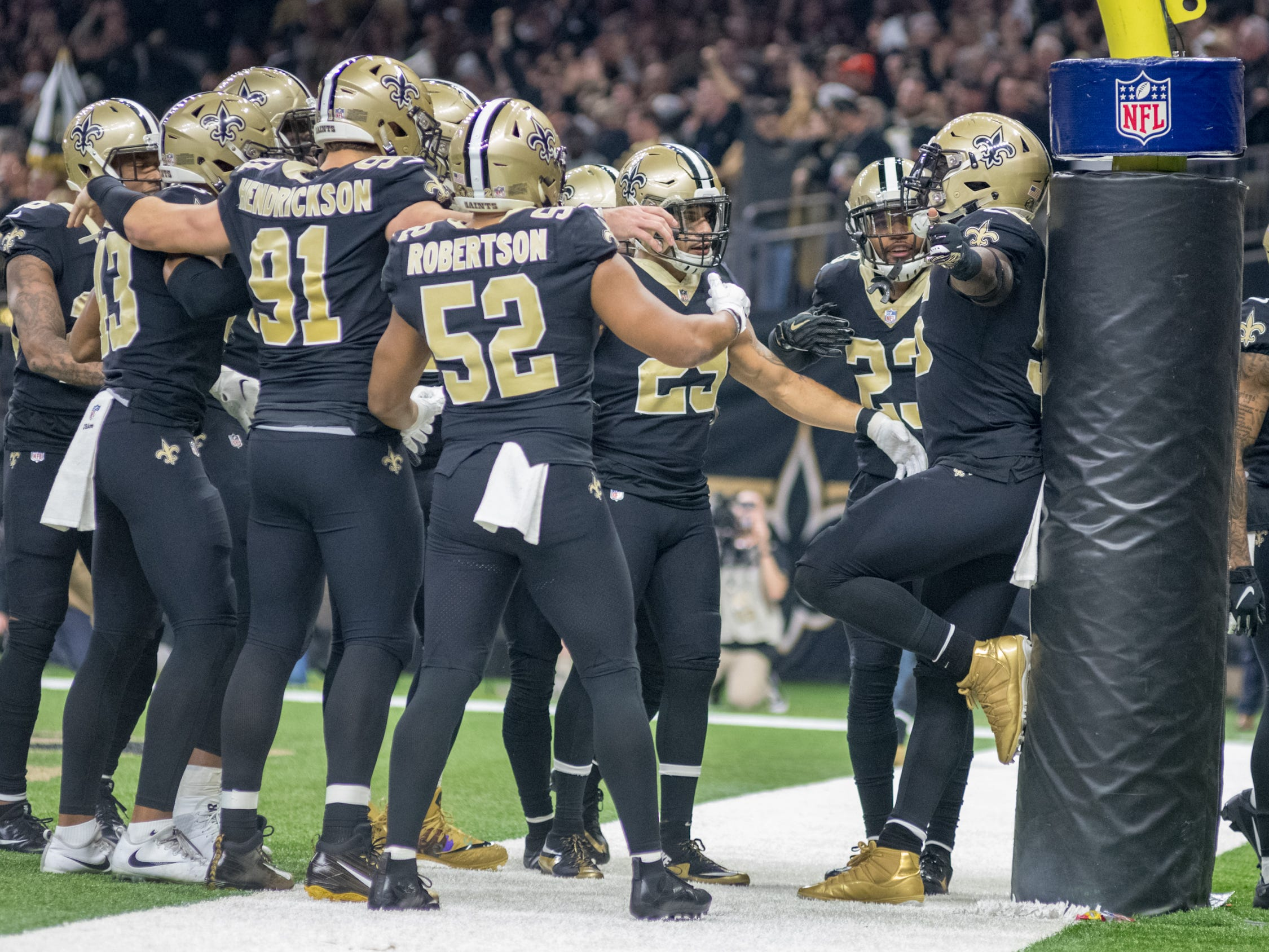 The Saints defense celebrates in the endzone during the NFC Championship playoff football game between the New Orleans Saints and the Los Angeles Rams at the Mercedes-Benz Superdome in New Orleans. Sunday, Jan. 20, 2019.