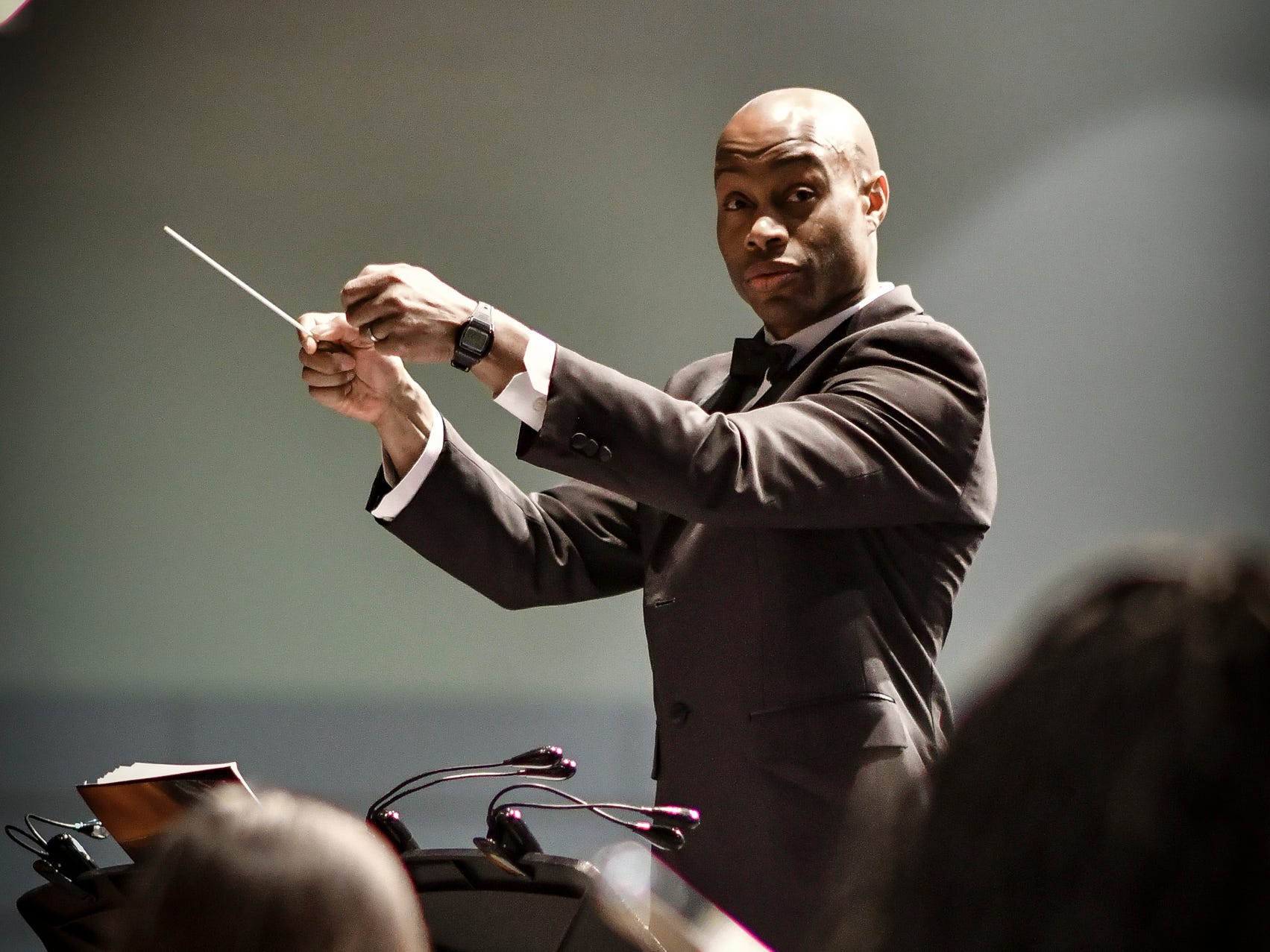 Music of Dream Orchestra Conductor Rodney Page conducts Monday, Jan. 21, 2019, at the 34th Annual MLK Holiday Luncheon Celebration at The Lansing Center in downtown Lansing, Michigan.  [AP Photo/Matthew Dae Smith/Lansing State Journal]
