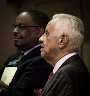 Former Virginia Governor L. Douglas Wilder listens to the music of Pastor Donnie McClurkin before his keynote address Monday, Jan. 21, 2019, at the 34th Annual MLK Holiday Luncheon Celebration at The Lansing Center in downtown Lansing, Michigan.  Wilder was the first elected African American Governor in the US (Virginia - 1990).  He first introduced a bill to have a holiday named for Martin Luther King, Jr..  It took eight years to pass.  Virginia was the first state to have a legislative holiday in Dr. King's honor.  Also pictured is Commissioner Tony Baltimore.