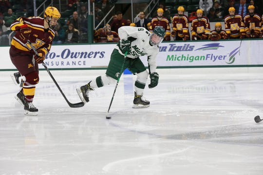 Sophomore forward Mitch Lewandowski handles the puck in Saturday's game against Minnesota. Lewandowski had two goals in both games this weekend, as MSU swept the Golden Gophers by scores of 5-3 each night.
