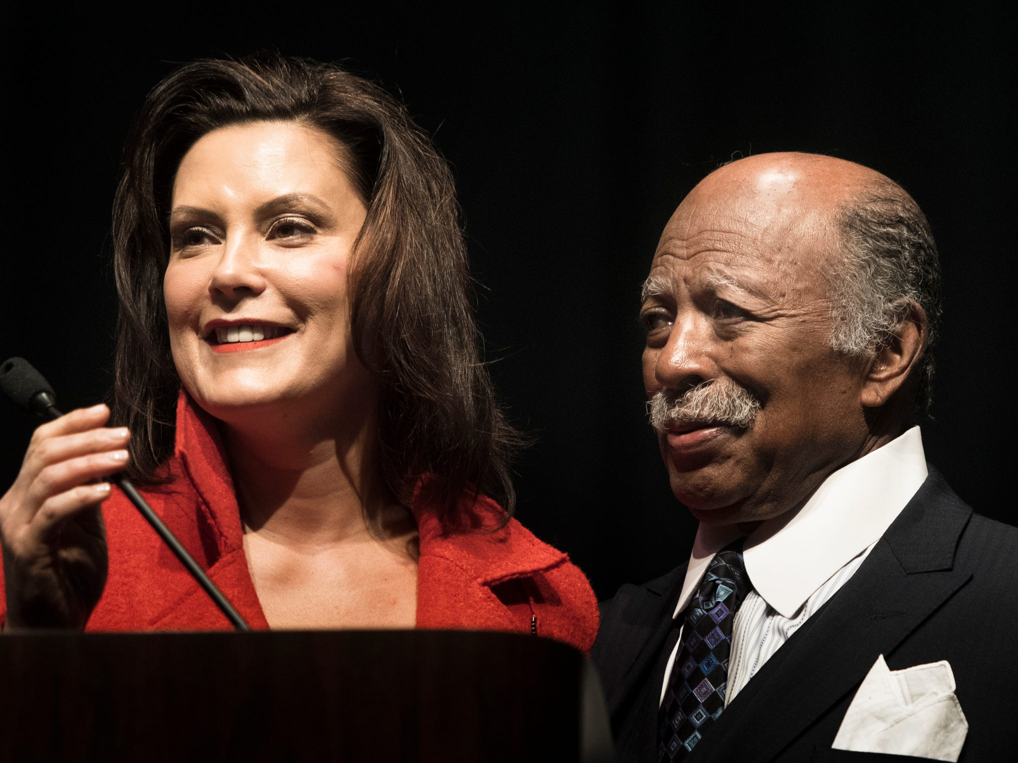 Michigan Governor Gretchen Whitmer talks about Gregory Eaton, right, recipient of the King Legacy & Service Award, Monday, Jan. 21, 2019, at the 34th Annual MLK Holiday Luncheon Celebration at The Lansing Center in Lansing, Michigan.  Eaton was the first black lobbyist in Michigan to work for a multi-cleint firm.  Eaton gave Magic Johnson a job when he was in high school.  He also owns Detroit-based Metro cars, and Gregory's Soul Food on Martin Luther King Jr. Blvd. in Lansing.  [AP Photo/Matthew Dae Smith/Lansing State Journal]