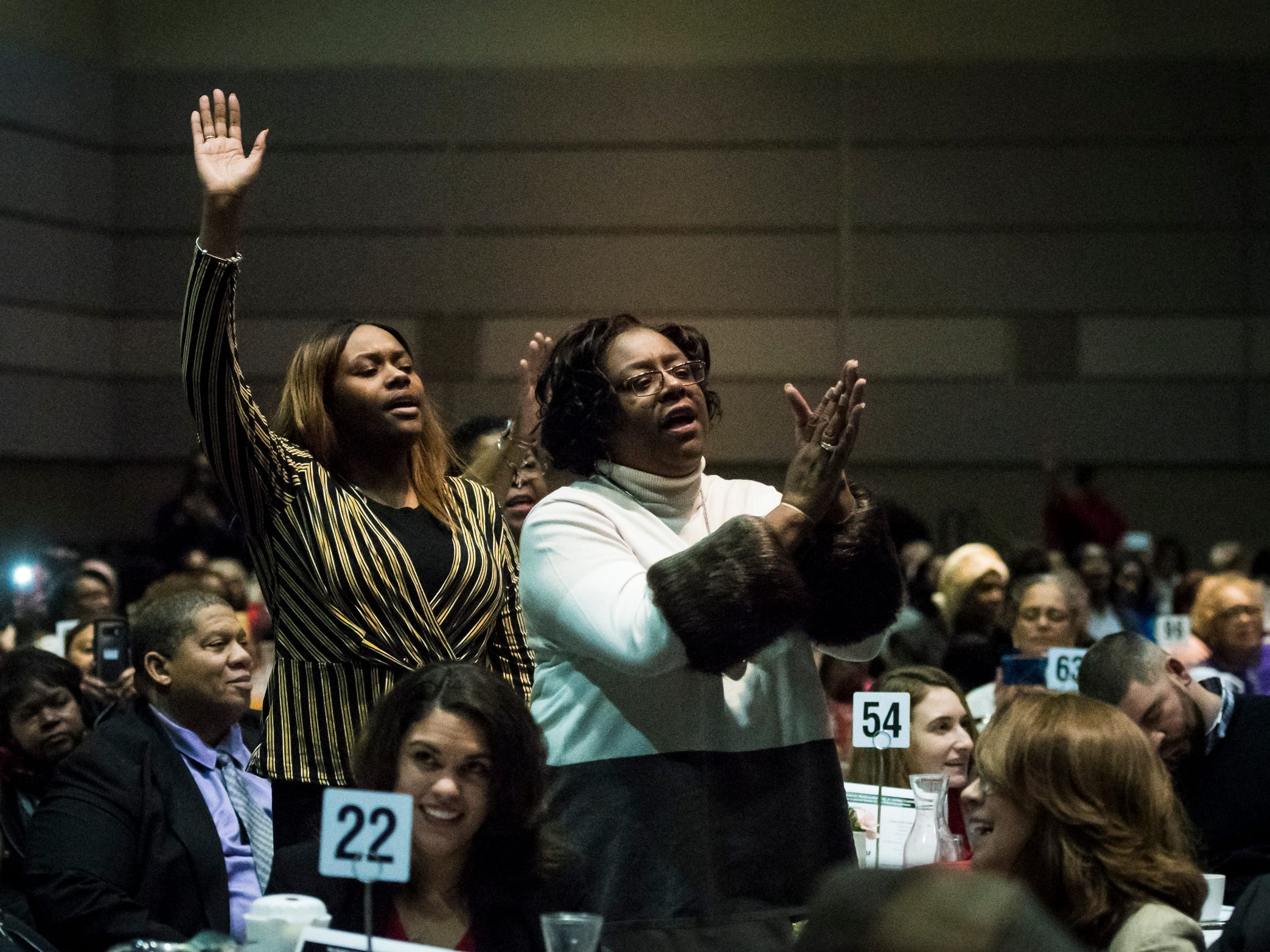 Attendees of the 34th Annual MLK Holiday Luncheon Celebration react to the songsmanship of Pastor Donnie McClurkin, Jr. of Perfecting Faith Church in Freeport, New York, as he performs Monday, Jan. 21, 2019, at The Lansing Center in downtown Lansing, Michigan.  McClurkin is an American gospel singer and minister, and has won many awards, inluding three Grammy Awards.  [AP Photo/Matthew Dae Smith/Lansing State Journal]
