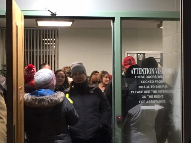 The Madison Board of Education entered into executive session Monday night and board president Jeff Meyers said no action would be taken afterward. A crowd of teachers and residents filled the board office lobby on Grace Street.
