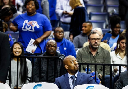 Memphis video coordinator Derrick Mallison (bottom) before action against SMU at the FedExForum, Saturday, January 19, 2019.