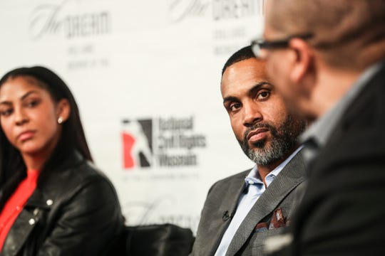 Former NBA player Grant Hill listens as Marc Spears, senior NBA writer for The Undefeated, speaks during the Intersection of Race & Sports panel discussion at the National Civil Rights Museum on Sunday.