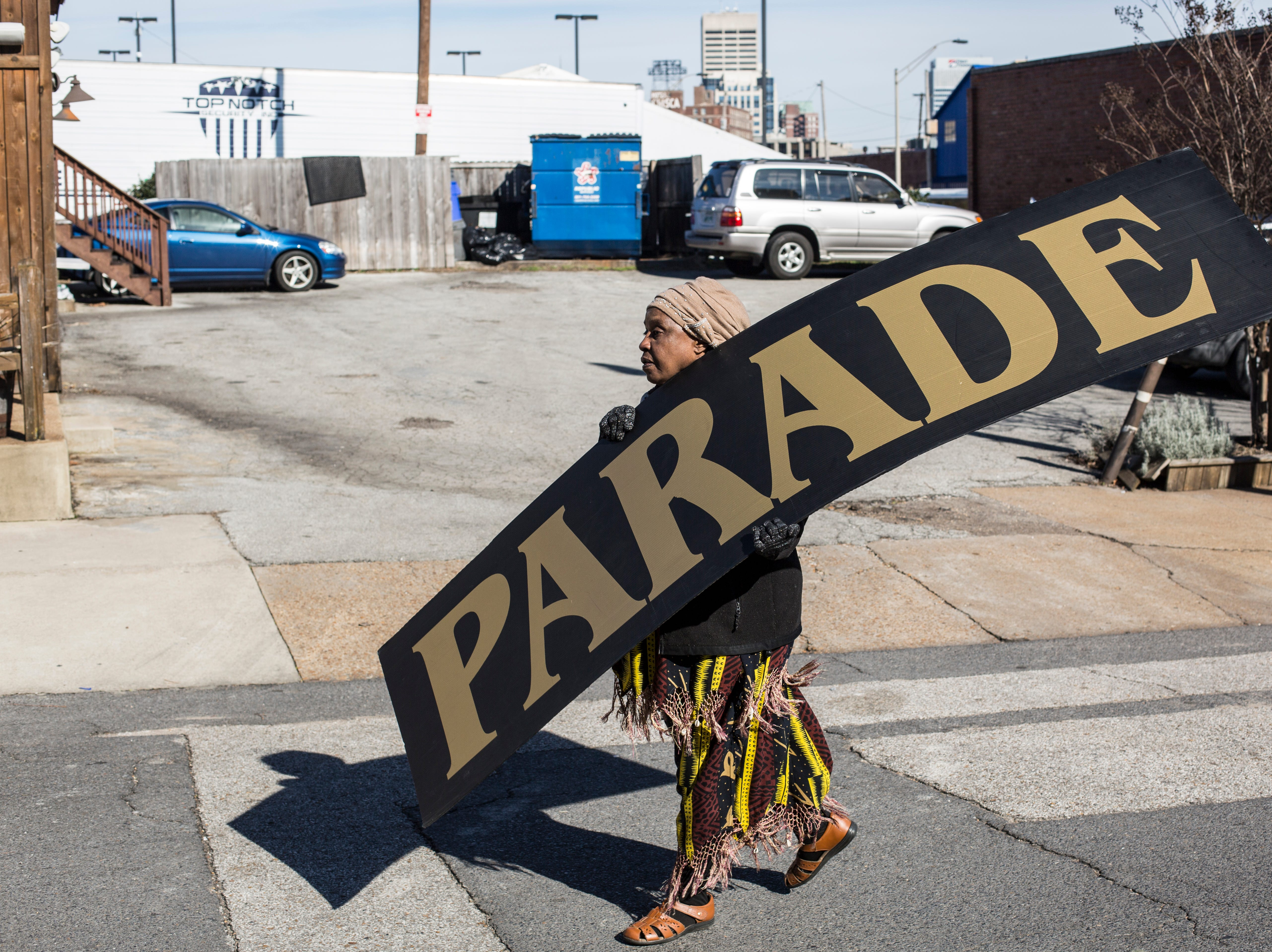 January 21 2019 - Sandra Hebron carries away a sign after finishing the annual Martin Luther King Jr. Holiday Parade.
