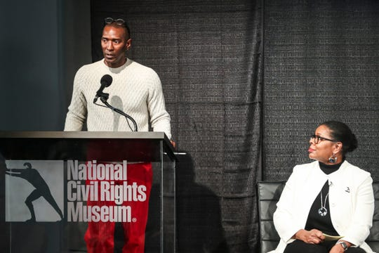 Elliot Perry, former NBA player and local minority owner of the Memphis Grizzlies, speaks at the start of the Intersection of Race & Sports panel discussion at the National Civil Rights Museum on Sunday.