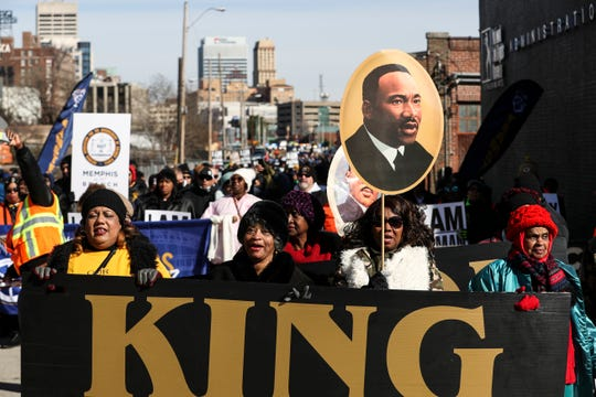 January 21 2019 - Participants in the annual Martin Luther King Jr. Holiday Parade walk up St. Martin Street towards the National Civil Rights Museum in Memphis Monday morning. Many braved the cold to join the march from the Pinch District to the National Civil Rights Museum to commemorate the birthday of civil rights leader Martin Luther King Jr.