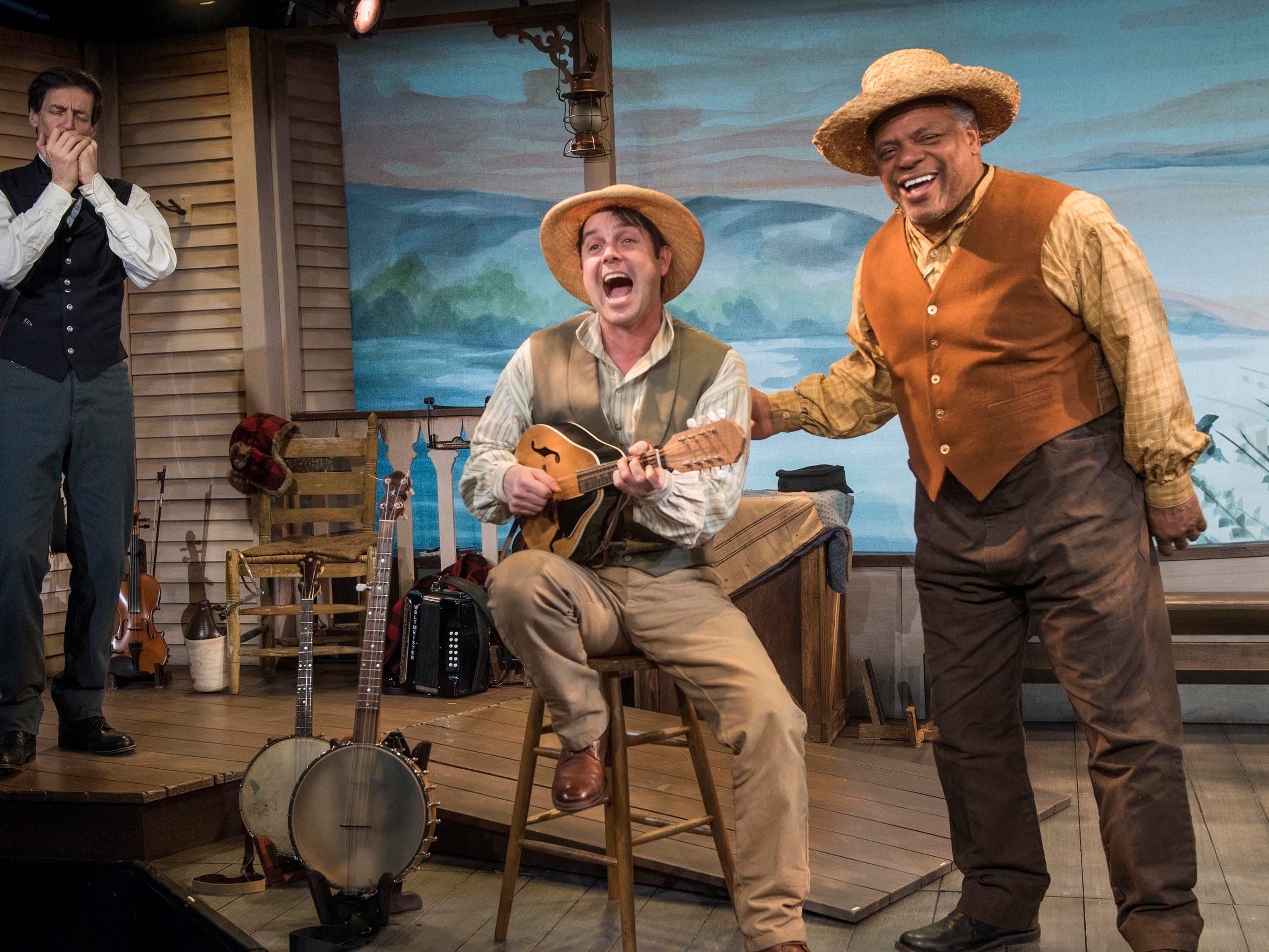 """David Lutken (left) plays harmonica while Spiff Weigand and Harvy Blanks sing in """"Mark Twain's River of Song,"""" staged by Milwaukee Repertory Theater at the Stackner Cabaret."""
