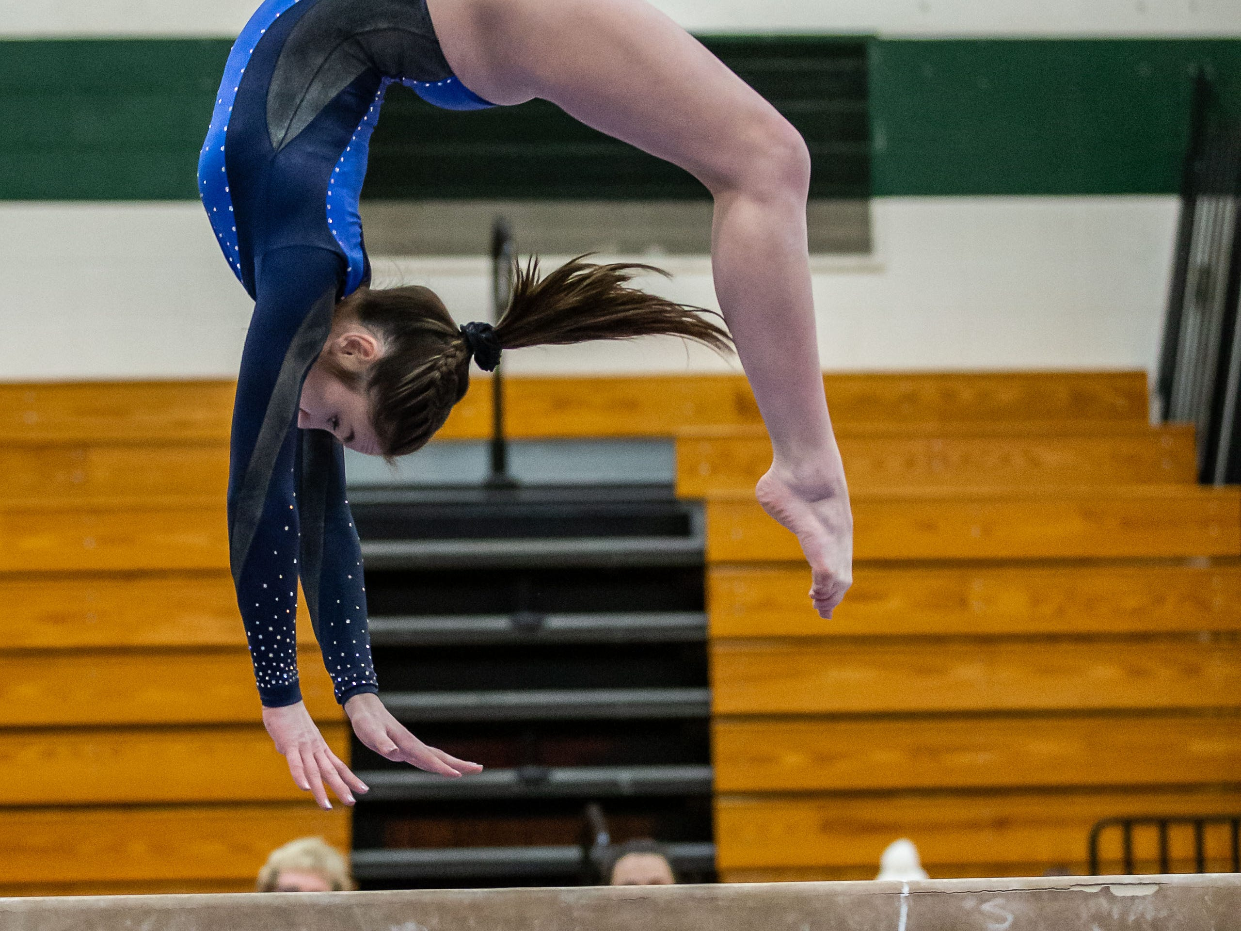 Brookfield gymnast Riley Feng competes on the beam during the meet at Nathan Hale in West Allis on Wednesday, Jan. 16, 2019.