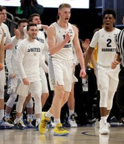 Marquette forward Sam Hauser reacts after draining a shot against Providence and getting fouled in process during the second half Sunday.