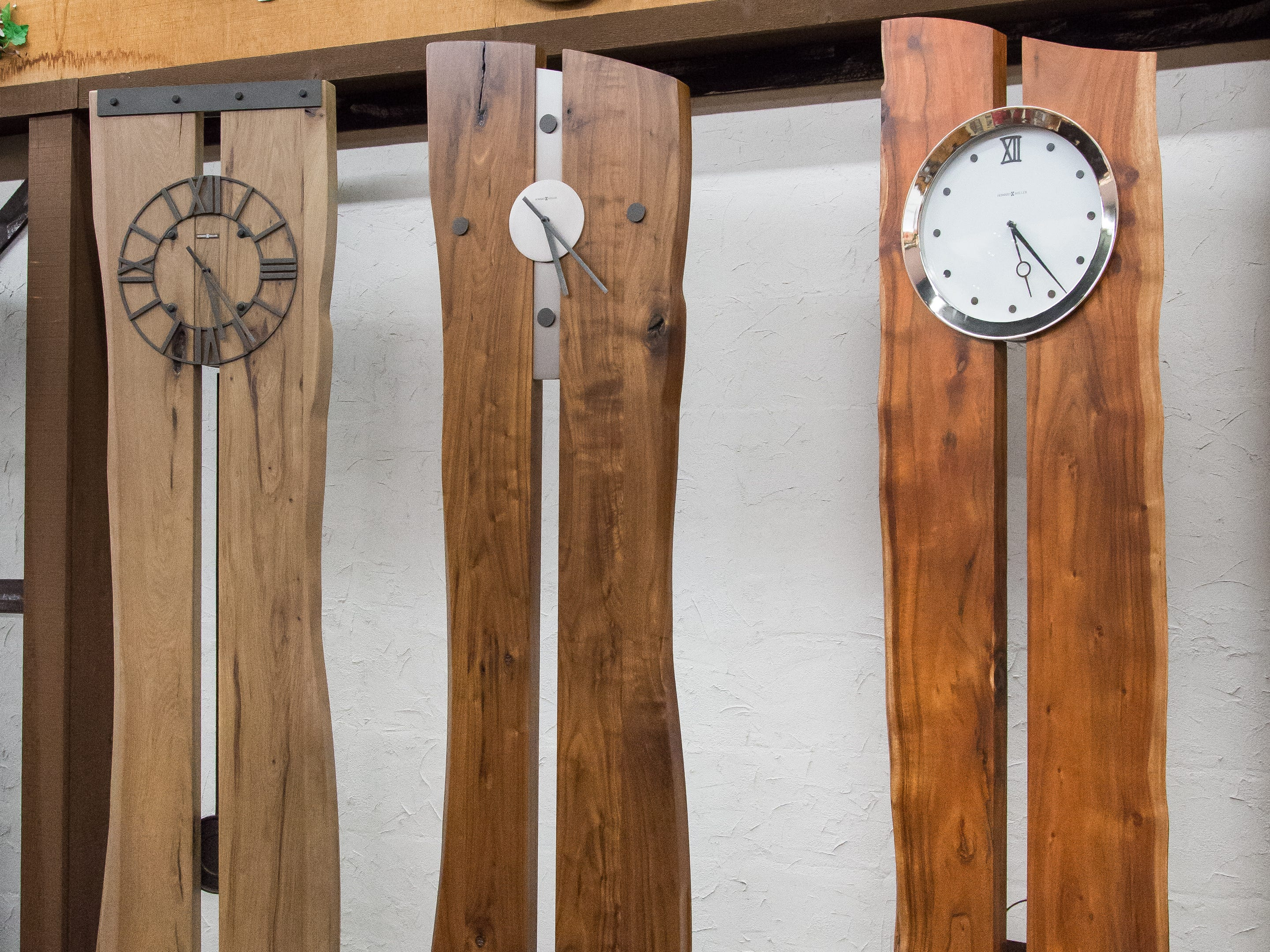 Live-edge floor clocks are made of different hardwoods including solid hickory, walnut and acacia. About 82 inches tall, they're priced at $1,549 to $1,699 at the Little Swiss Clock Shop.