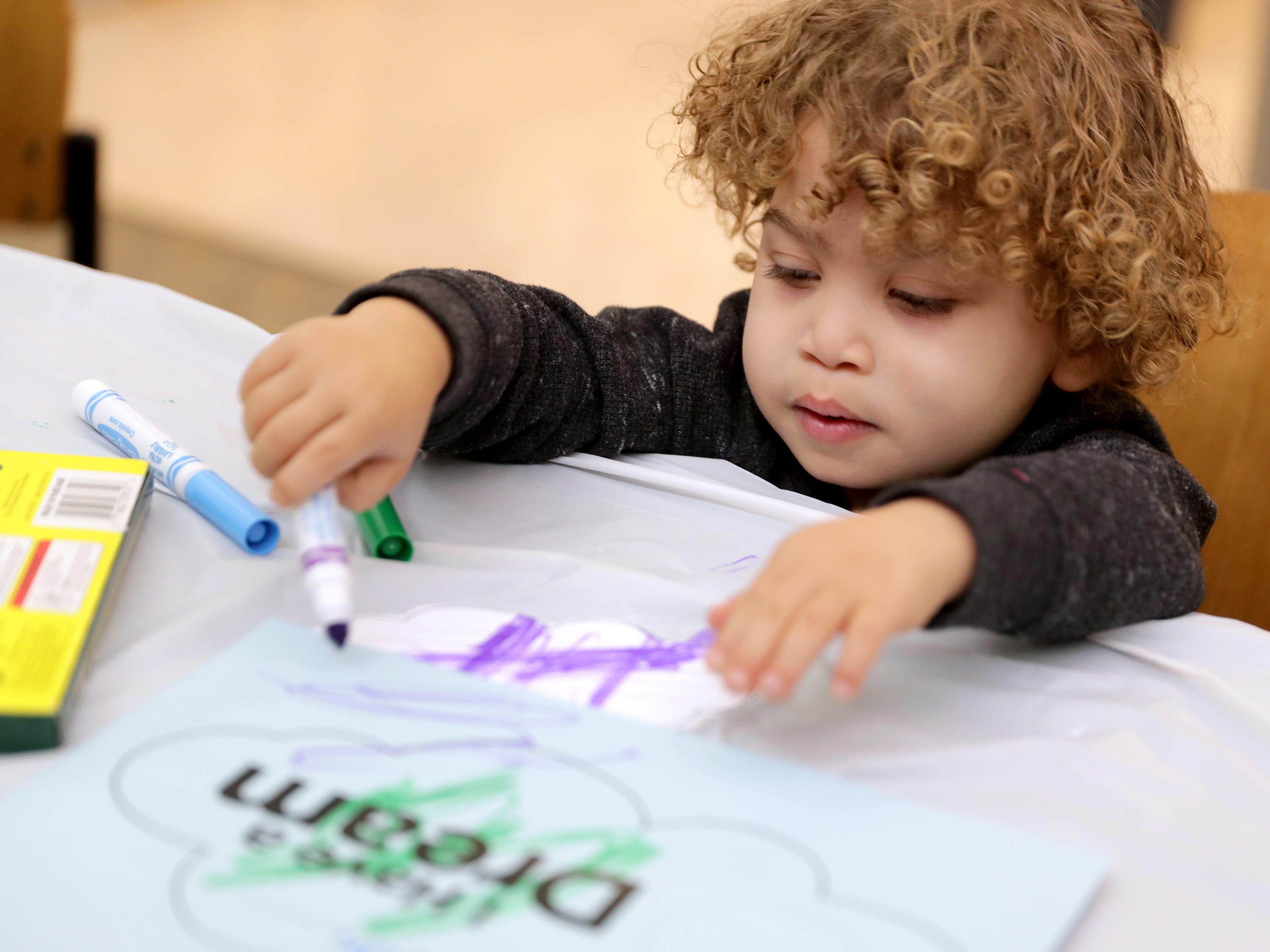 Nathan Kirchhoff Jr., 2,  colors in the crafting area. He was with his mother, Tenisha Kirchhoff of West Milwaukee, during a celebration at Dr. Martin Luther King Library on West Locust Street in Milwaukee.