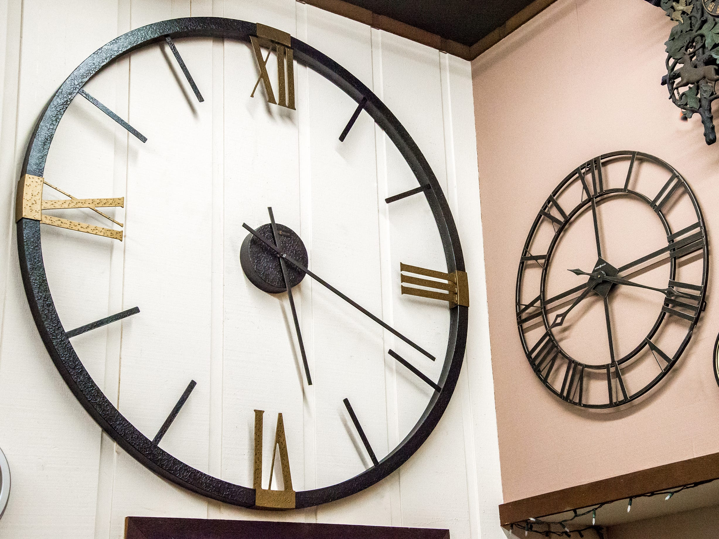 Today's newer homes, with cathedral ceilings, often call for large pieces of art. This wrought-iron clock (at left, $729, Little Swiss Clock Shop) is 5 feet in diameter.