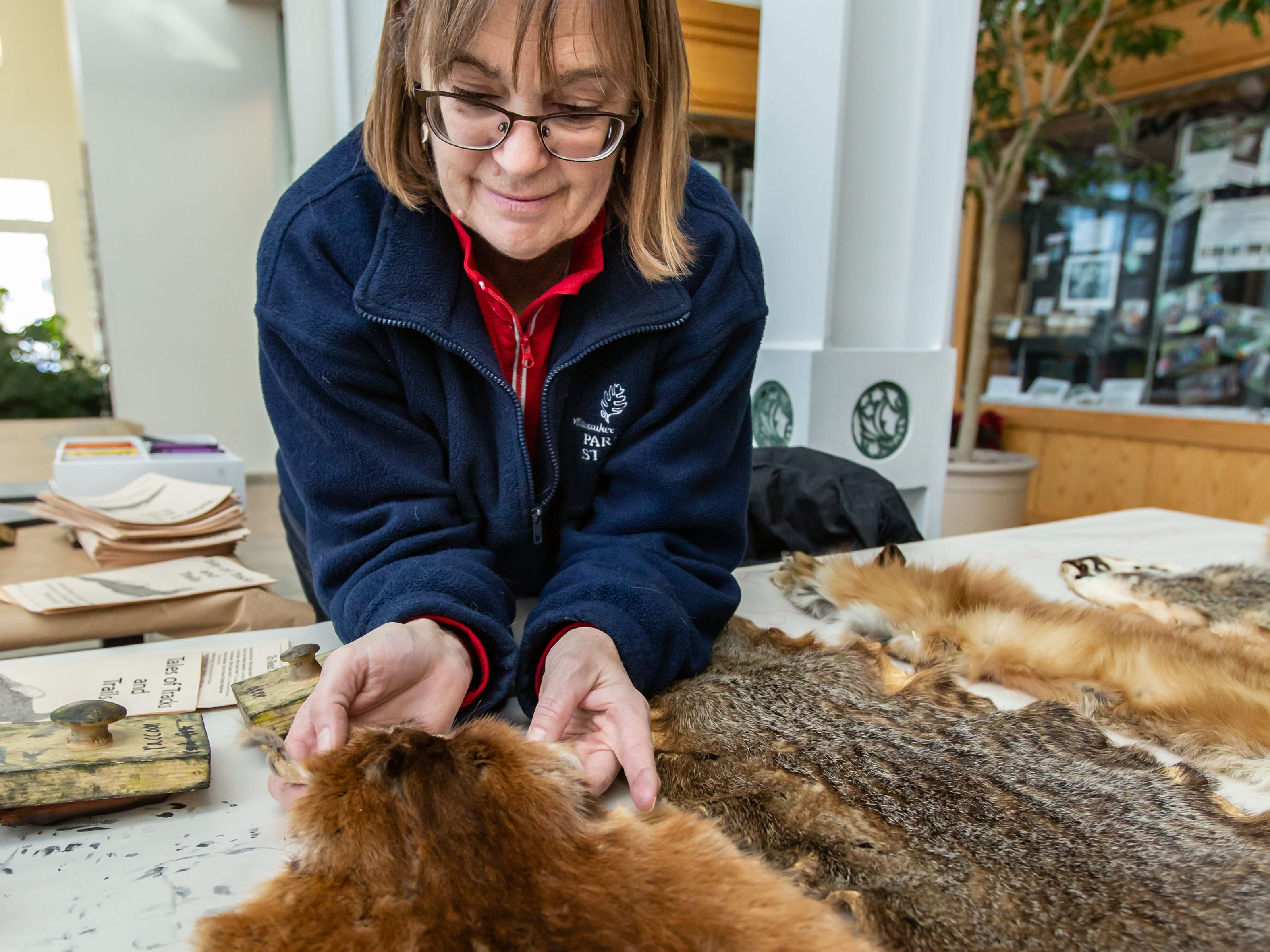 Deb McRae, Director of Wehr Nature Center in Franklin, explains the various properties of native animal pelts during Winterfest at Boerner Botanical Gardens in Hales Corners on Sunday, Jan. 20, 2019. The annual event, hosted by the Friends of Boerner Botanical Gardens, features children's crafts, informational displays, expert-led nature walks and more.