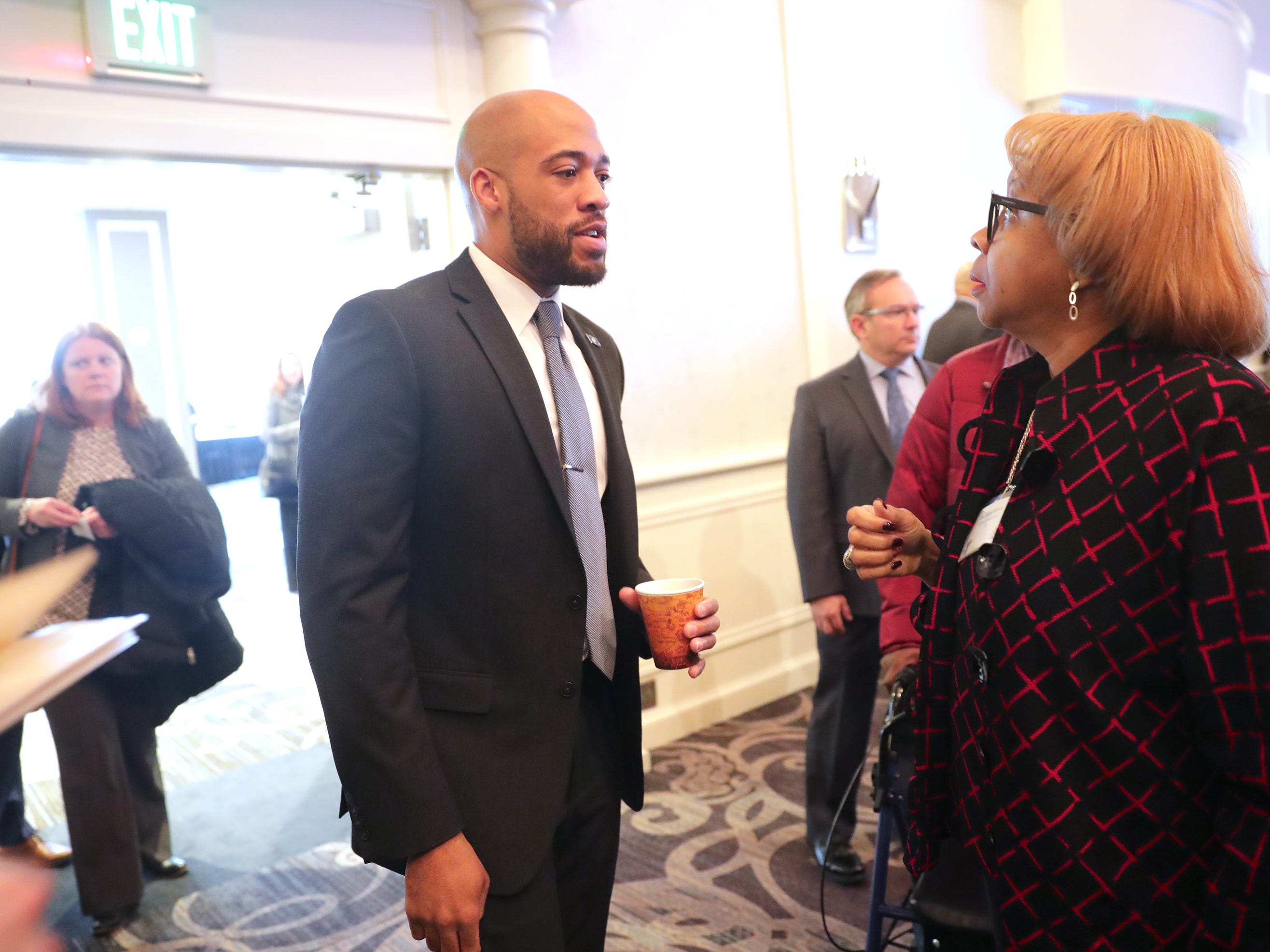 Lt. Gov. Mandela Barnes talks with Joan Prince of UW-Milwaukee at the YMCA of Metropolitan Milwaukee 22nd annual Dr. Martin Luther King Jr. celebration breakfast at the Italian Community Center in Milwaukee.