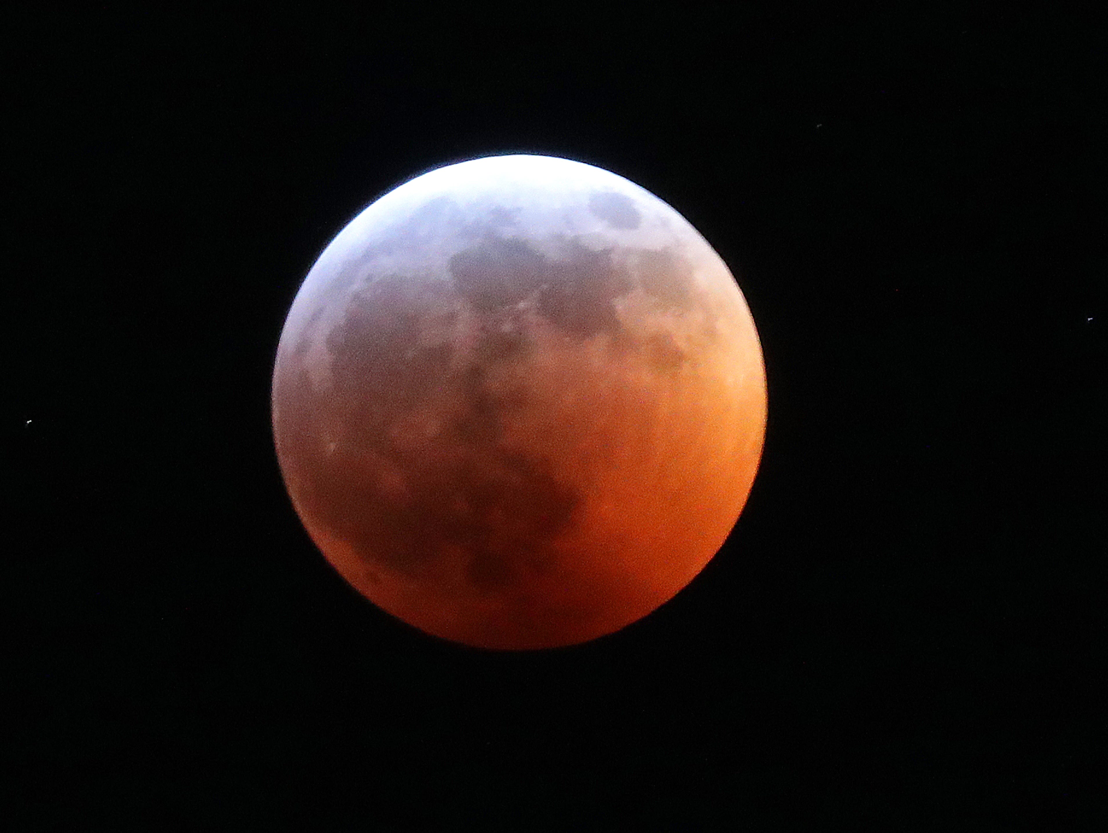 A total lunar eclipse blood moon is seen.  It's also a supermoon and wolf moon, which means the full moon is fairly close to Earth, sports a reddish tinge and happens during the month when Native Americans and others notice wolves frequently howling at Earth's nearest celestial neighbor.