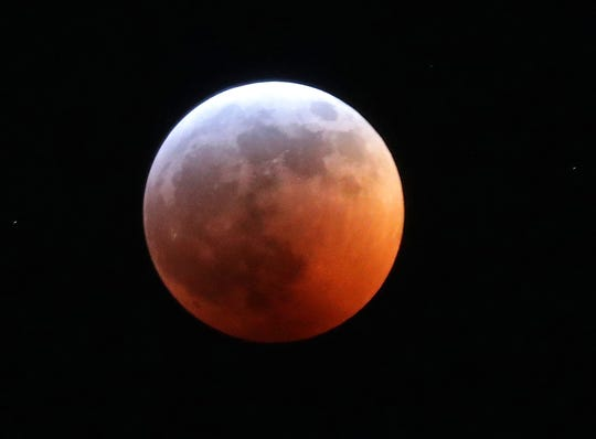 A blood moon is seen during a total lunar eclipse. It's also considered a supermoon and wolf moon, meaning the full moon is fairly close to Earth, sports a reddish tinge and happens during the month when Native Americans and others notice wolves frequently howling at Earth's nearest celestial neighbor.