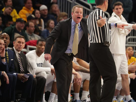 Marquette head coach Steve Wojciechowski argues a call with a referee during the Golden Eagles' game against Providence on Sunday.