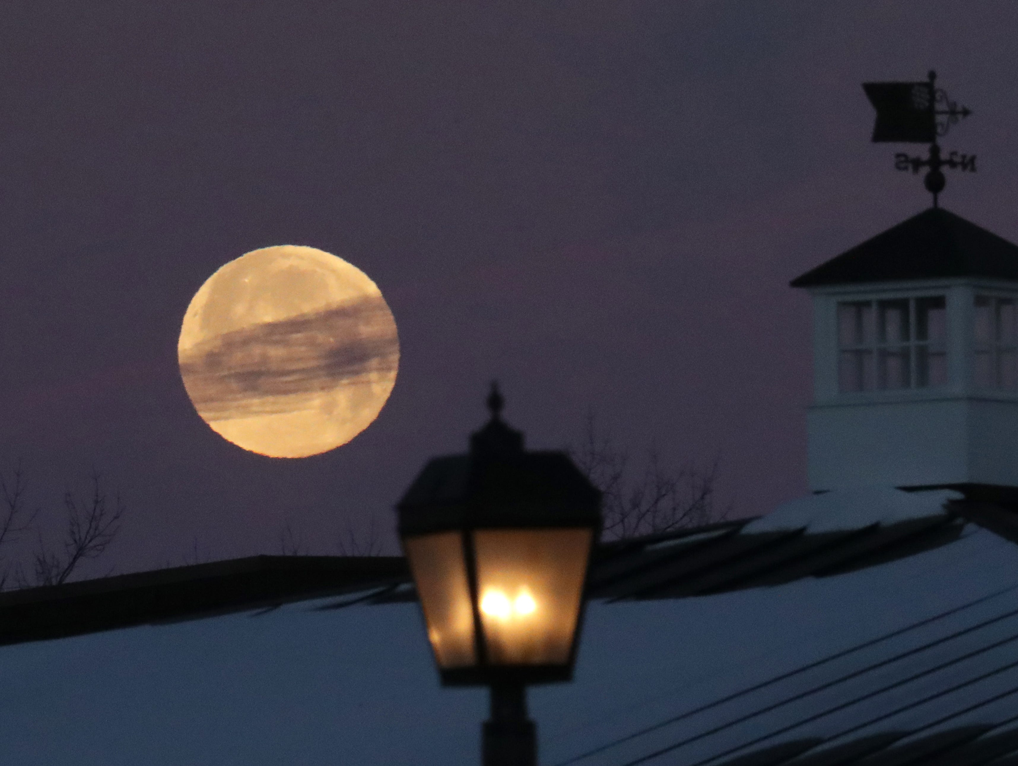 The nearly full moon after last night's lunar eclipse in Bayside.