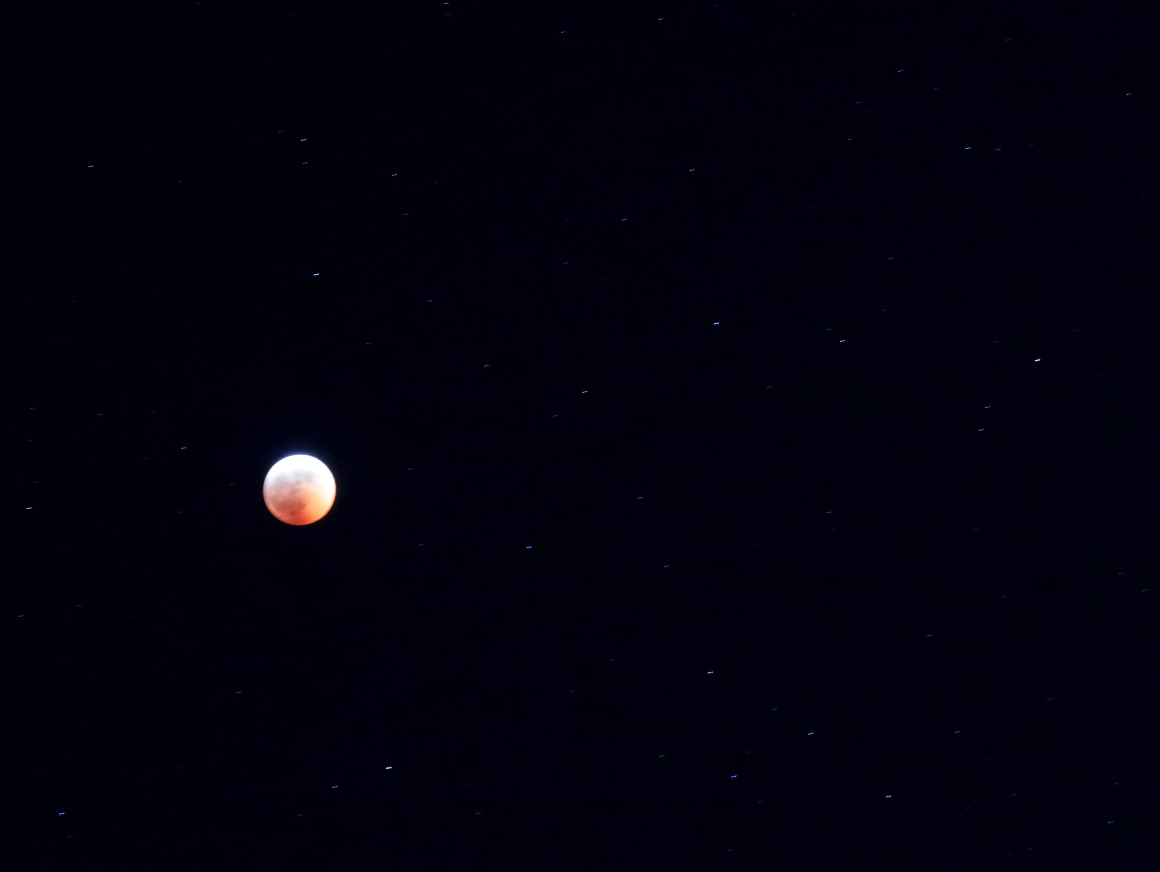 A total lunar eclipse blood moon is seen.
