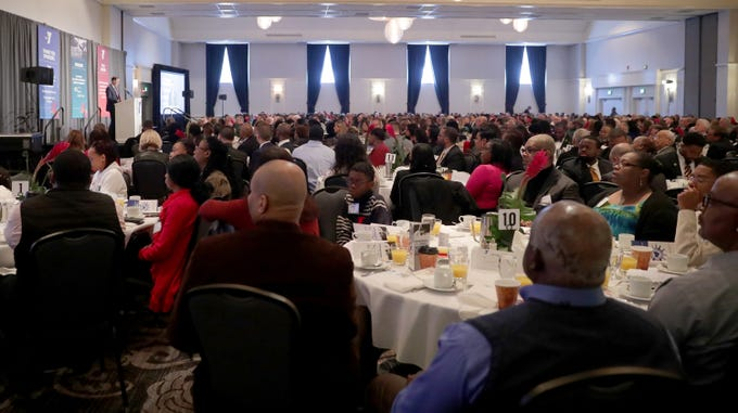 People attend the YMCA of Metropolitan Milwaukee 22nd annual Dr. Martin Luther King Jr. celebration breakfast at the Italian Community Center in Milwaukee.