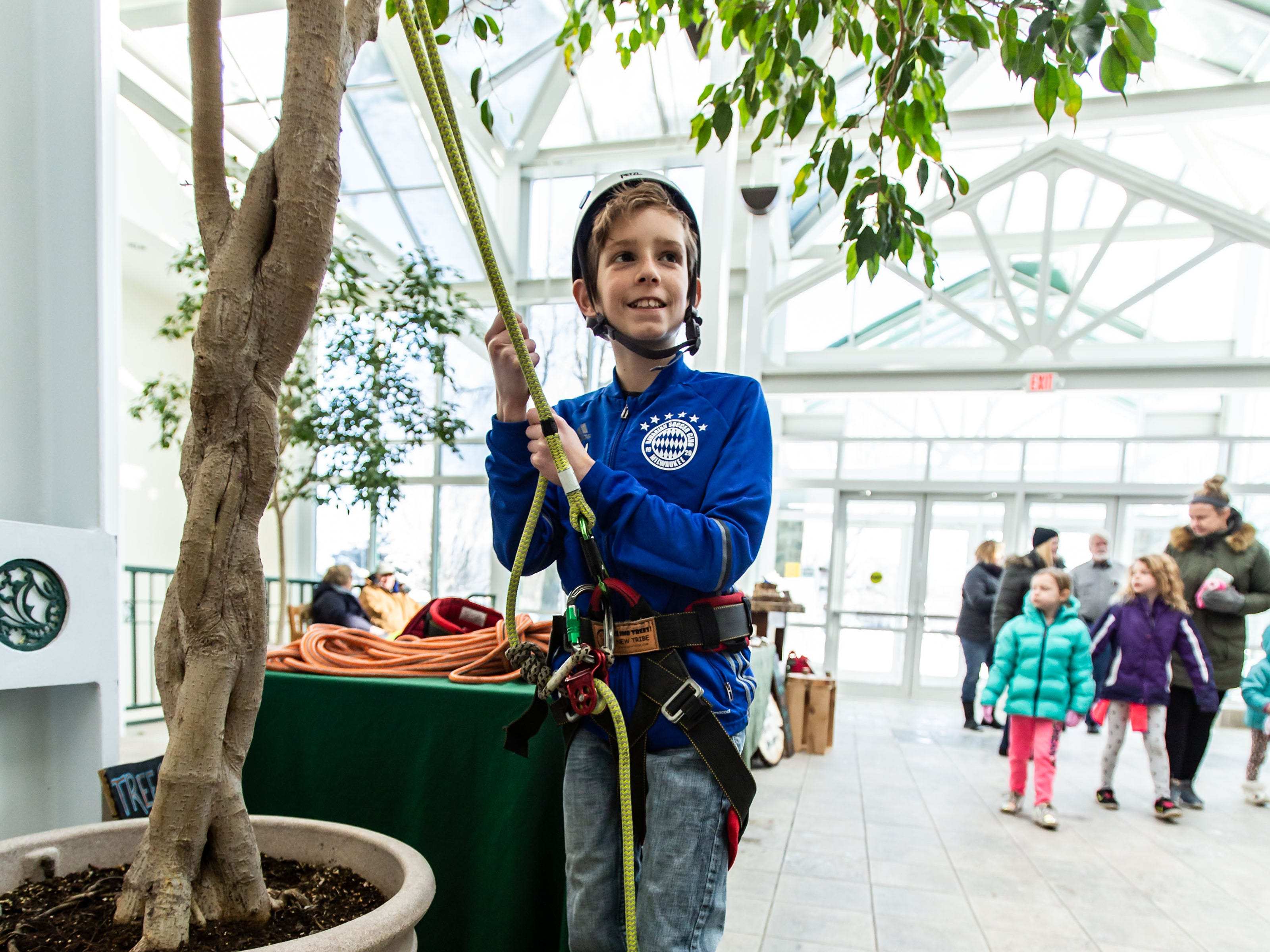 Matthias Varela, 12, of Franklin checks out an arborist's tree climbing rig during Winterfest at Boerner Botanical Gardens in Hales Corners on Sunday, Jan. 20, 2019. The annual event, hosted by the Friends of Boerner Botanical Gardens, features children's crafts, informational displays, expert-led nature walks and more.