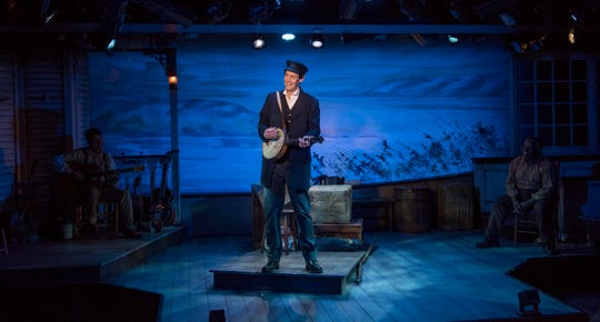 "Multi-instrumentalist David Lutken plays banjo in ""Mark Twain's River of Song,"" staged by Milwaukee Repertory Theater at the Stackner Cabaret."