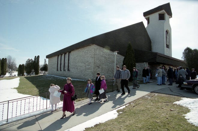 Parishoners leave the 10 a.m. mass Sunday morning, March 22, 1998 at St. Michael Catholic Church, Dane, WI. The church was closed after their former priest, Father Alfred Kunz, was murdered March 4th, on the church grounds.