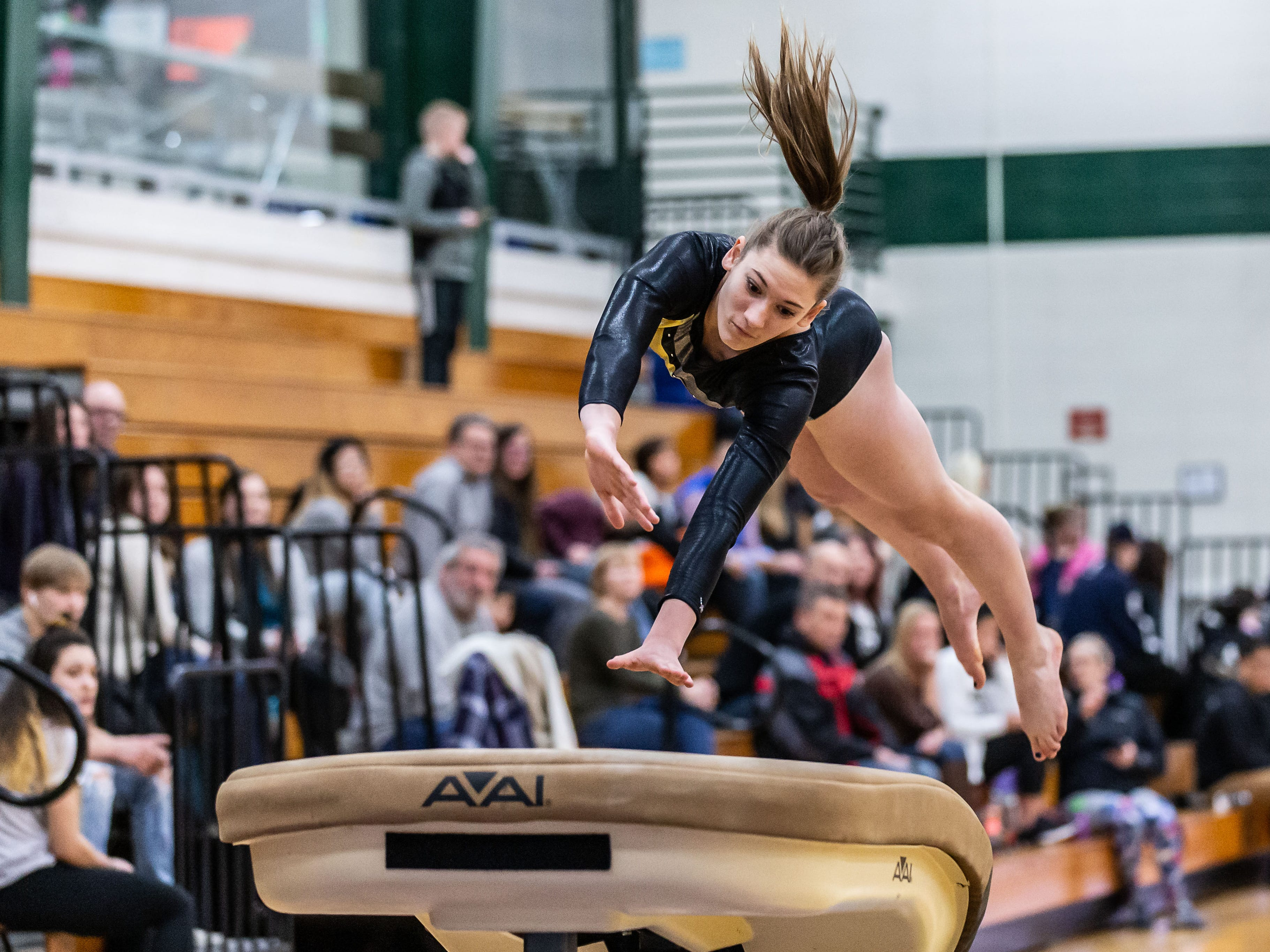 West Allis Nathan Hale/DSHA co-op gymnast Julia Klein competes on the vault during the meet at home against Brookfield on Wednesday, Jan. 16, 2019.