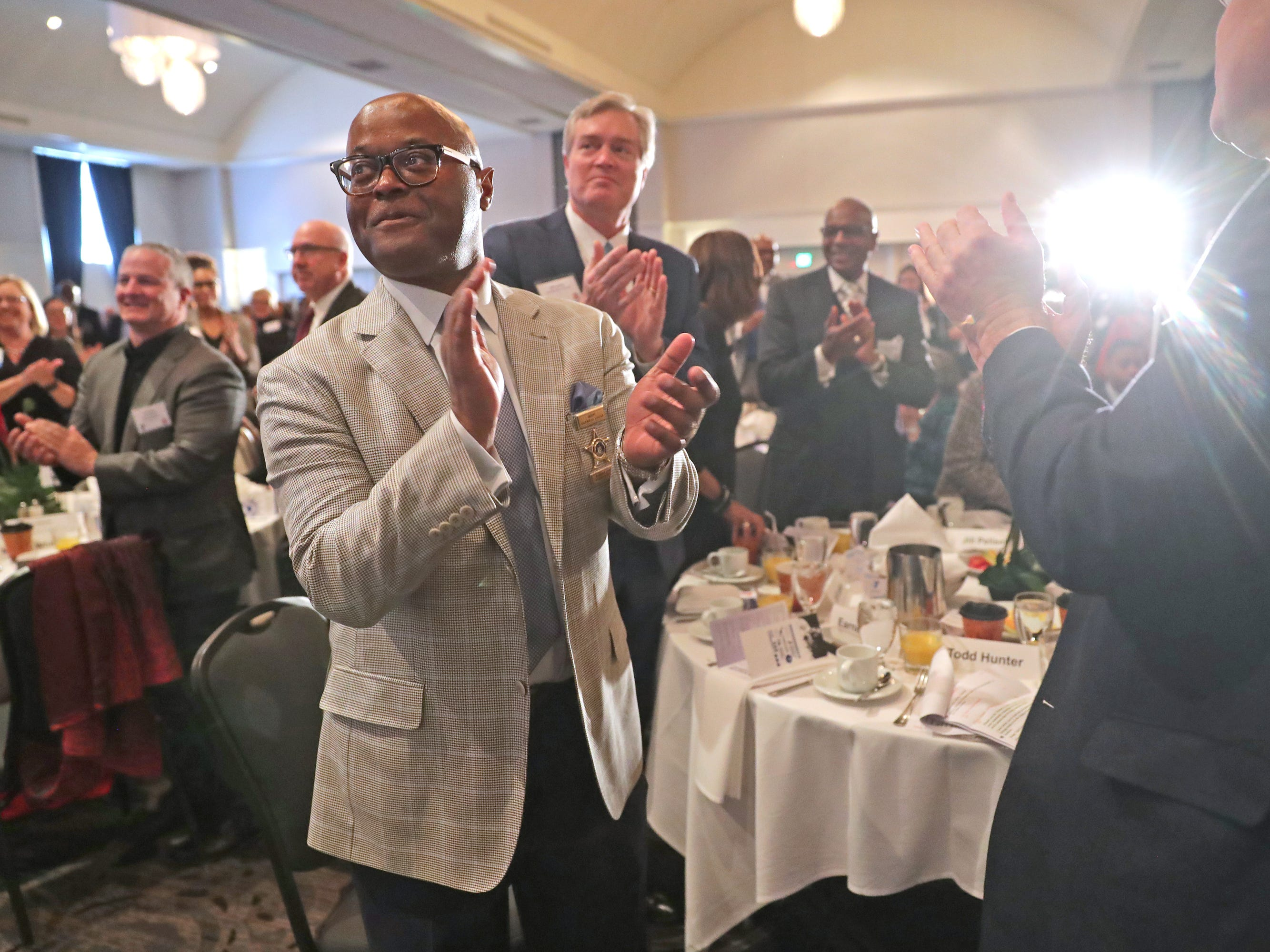 Milwaukee County Sheriff Earnell Lucas applauds a speaker at the YMCA of Metropolitan Milwaukee 22nd annual Dr. Martin Luther King Jr. celebration breakfast at the Italian Community Center in Milwaukee.