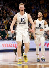 Marquette forward Sam Hauser  celebrates after hitting a three-pointer late in the game against Providence on Sunday.