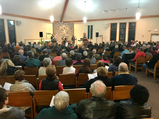 "Hundreds of people attend a ""praise and gratitude"" service celebrating the return of missing Barron teenager Jayme Closs at St. Peter's Catholic Church in Cameron on Sunday night."