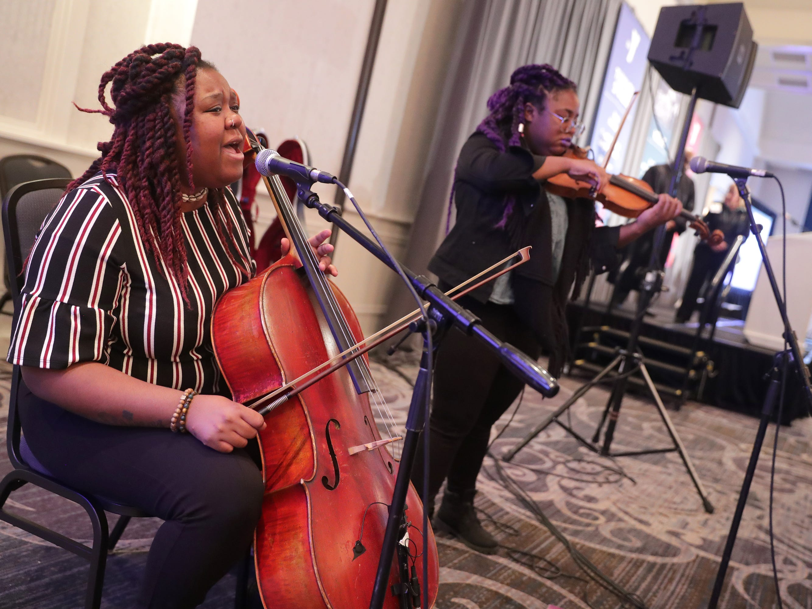 Monique Ross (left) on the cello and her sister Chauntee Ross on the violin perform as SistaStrings at the YMCA of Metropolitan Milwaukee 22nd annual Dr. Martin Luther King Jr. celebration breakfast at the Italian Community Center in Milwaukee.