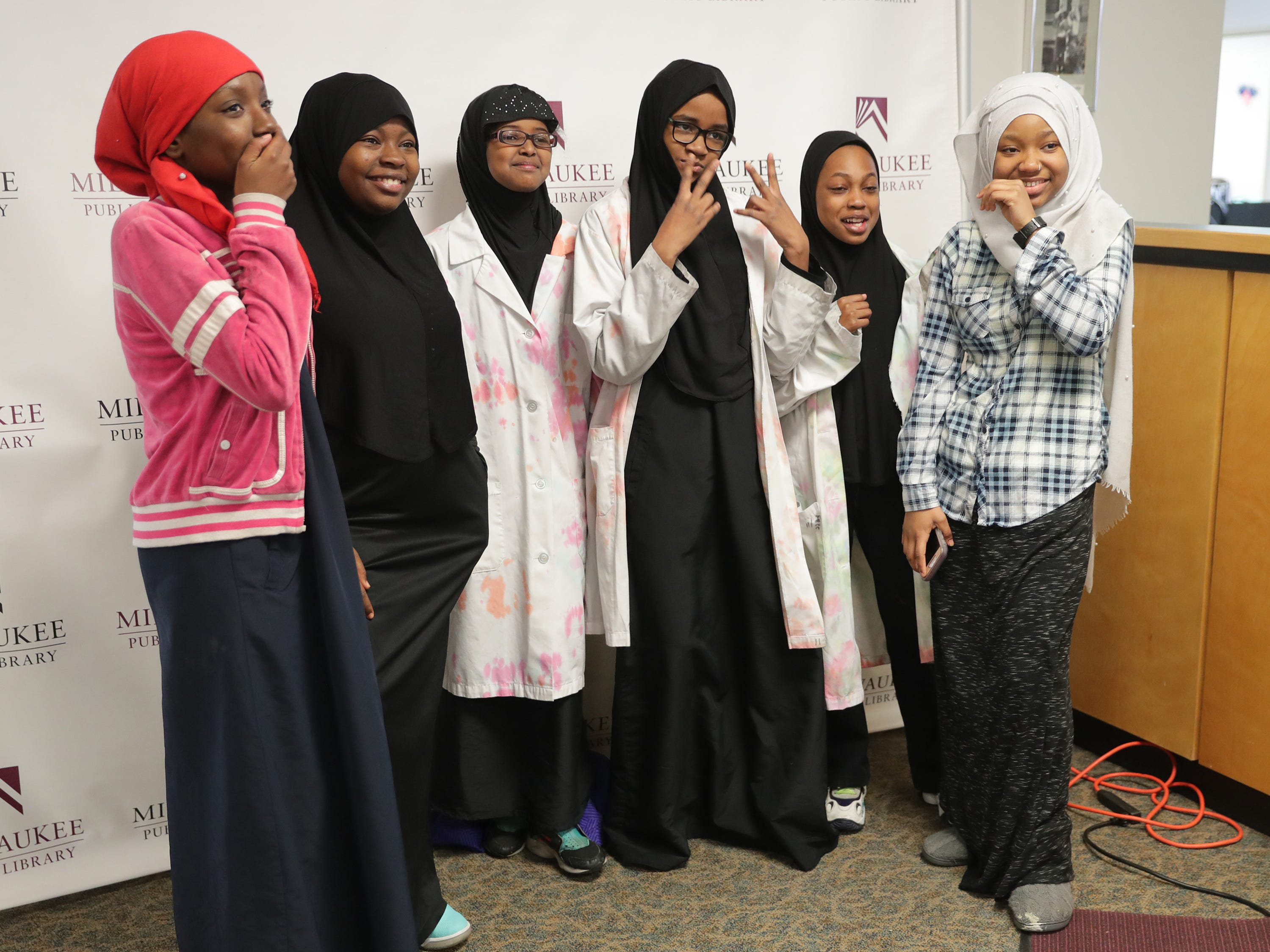 A group of students from Clara Mohammed School pose in the photo booth during a celebration of the life Dr. Martin Luther King Jr. at the King Library on West Locust Street in Milwaukee. With many Milwaukee Public Schools children off for the national holiday, the library featured activities and crafts for the whole family.
