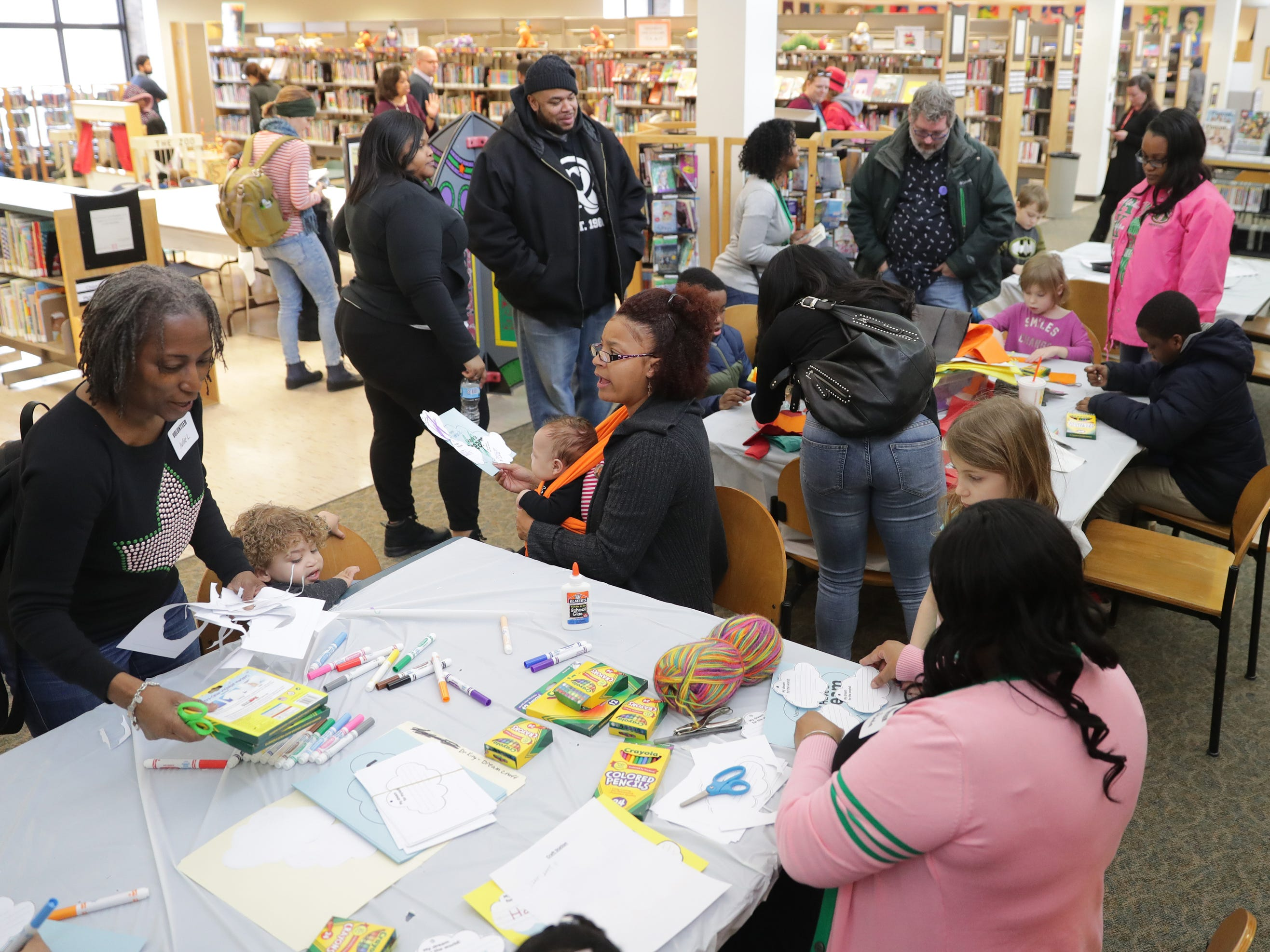 People visit the various stations during a celebration of the life of Dr. Martin Luther King at the King Library on West Locust Street in Milwaukee.