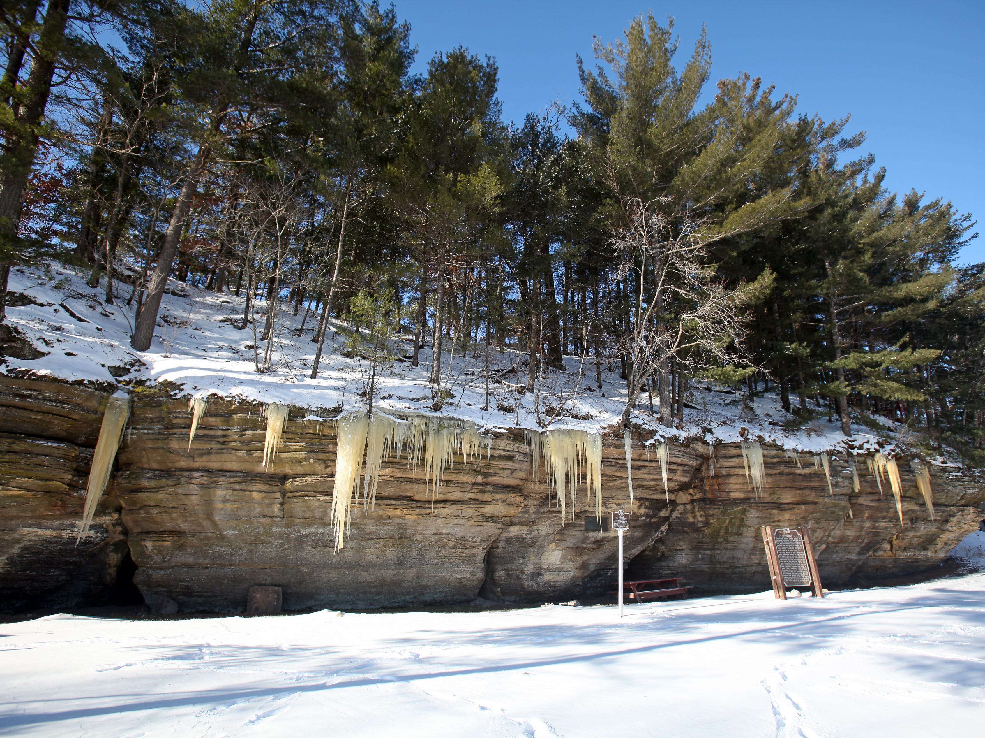 Large icicles cling to a sandstone cliff at Pier County Park in Rockbridge.