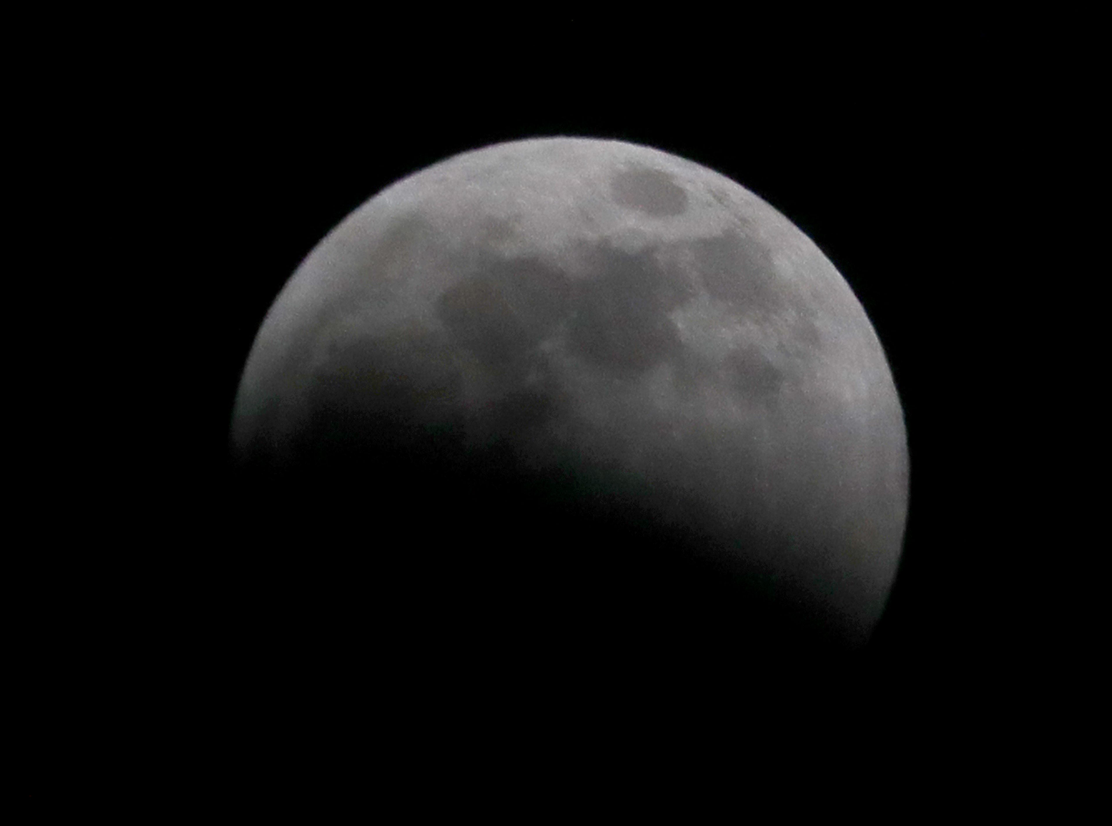 The start of a total lunar eclipse continues.